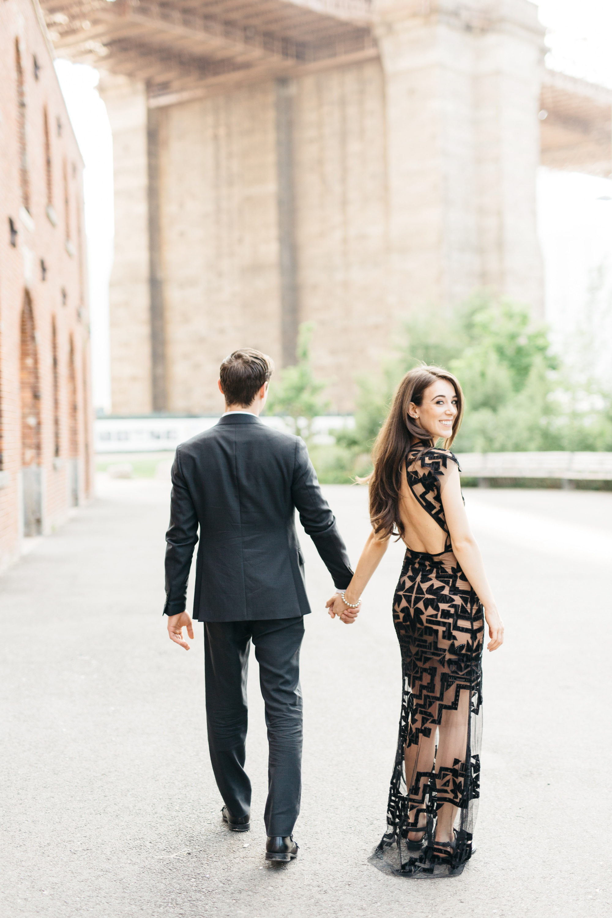 Couple walking near brooklyn bridge