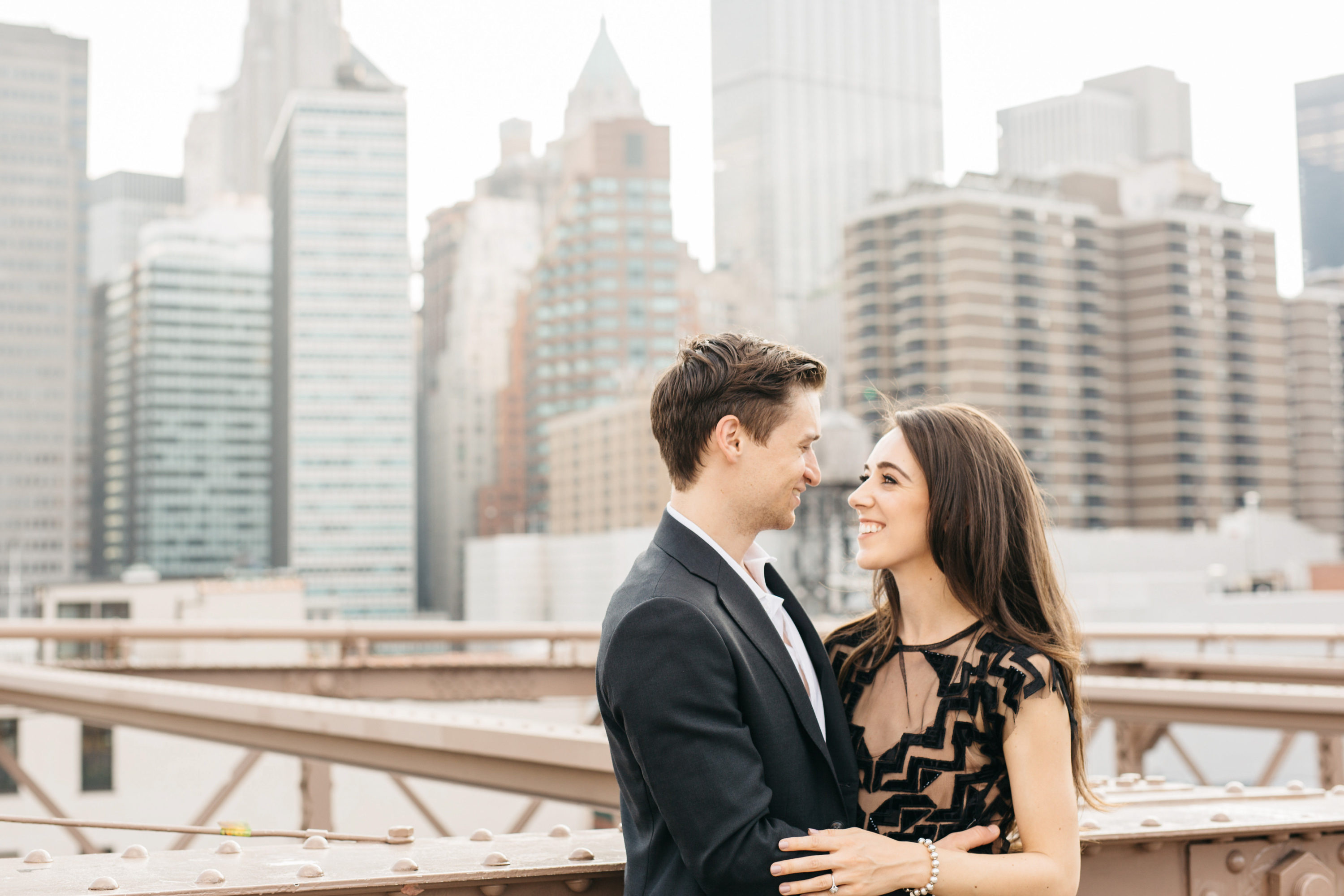 couple looking at eachother on brooklyn bridge