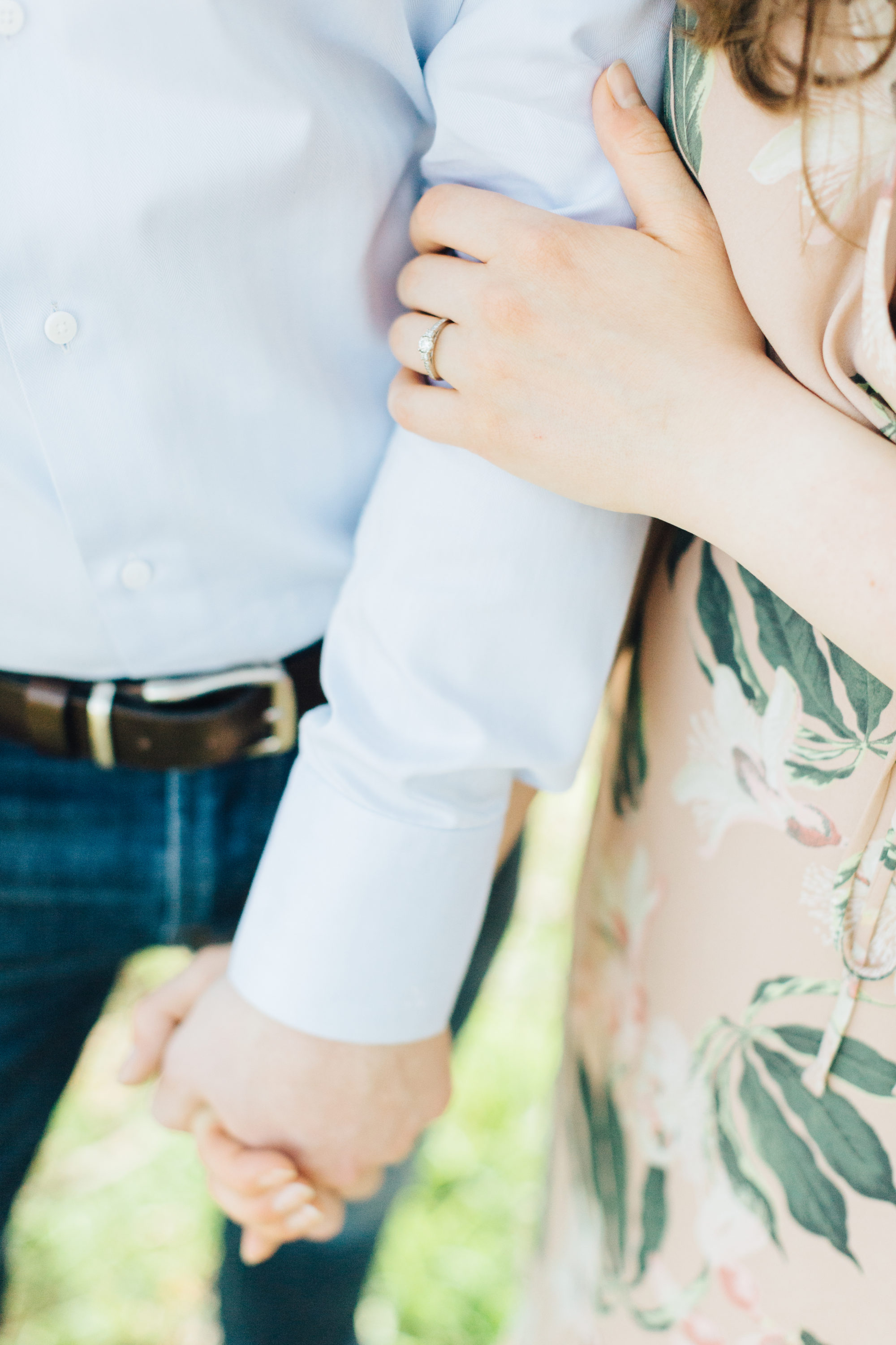 couple holding hands at engagement session at Cherry Beach