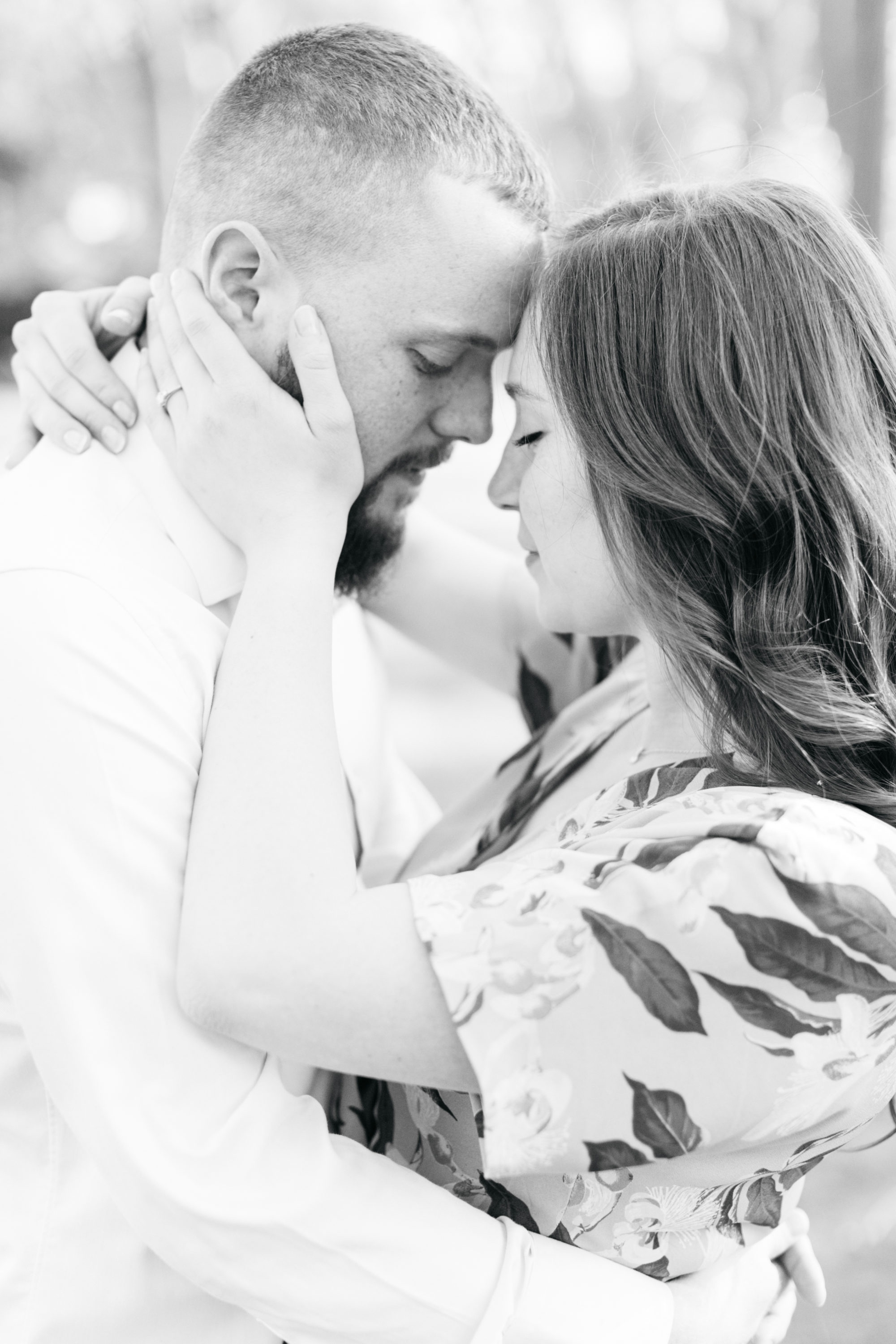 Couple cuddling at engagement session, Cherry beach