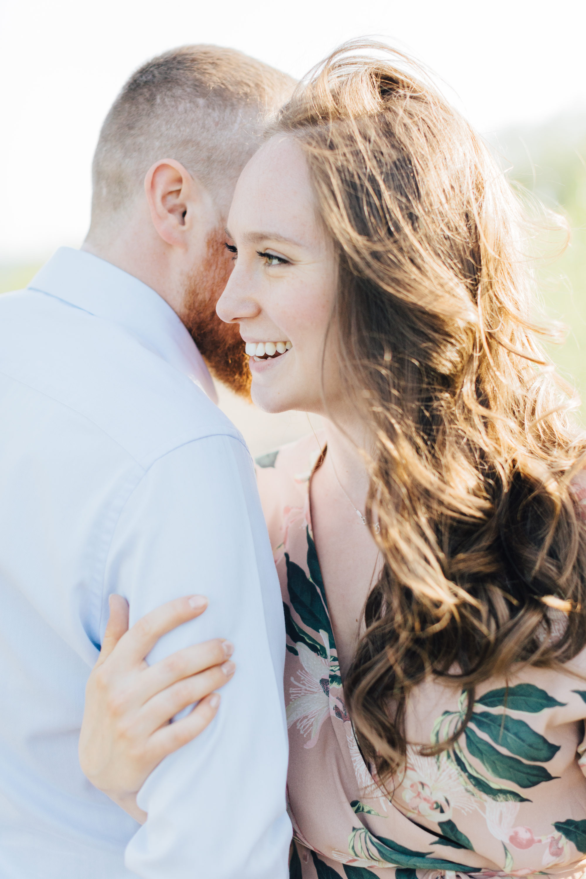 Couple laughing at Engagement session at Cherry beach