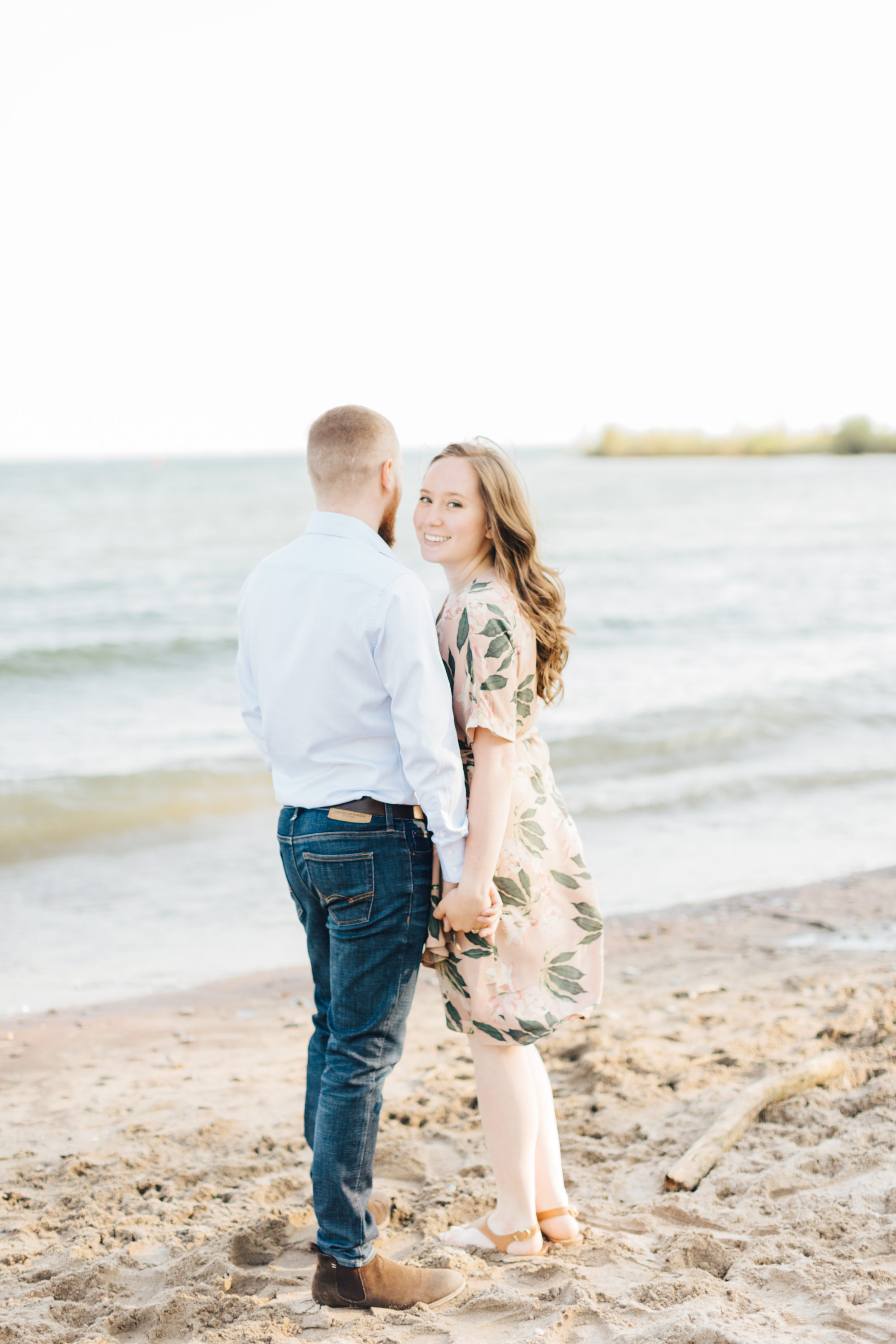 Bride to be smiling at engagement session at cherry beach