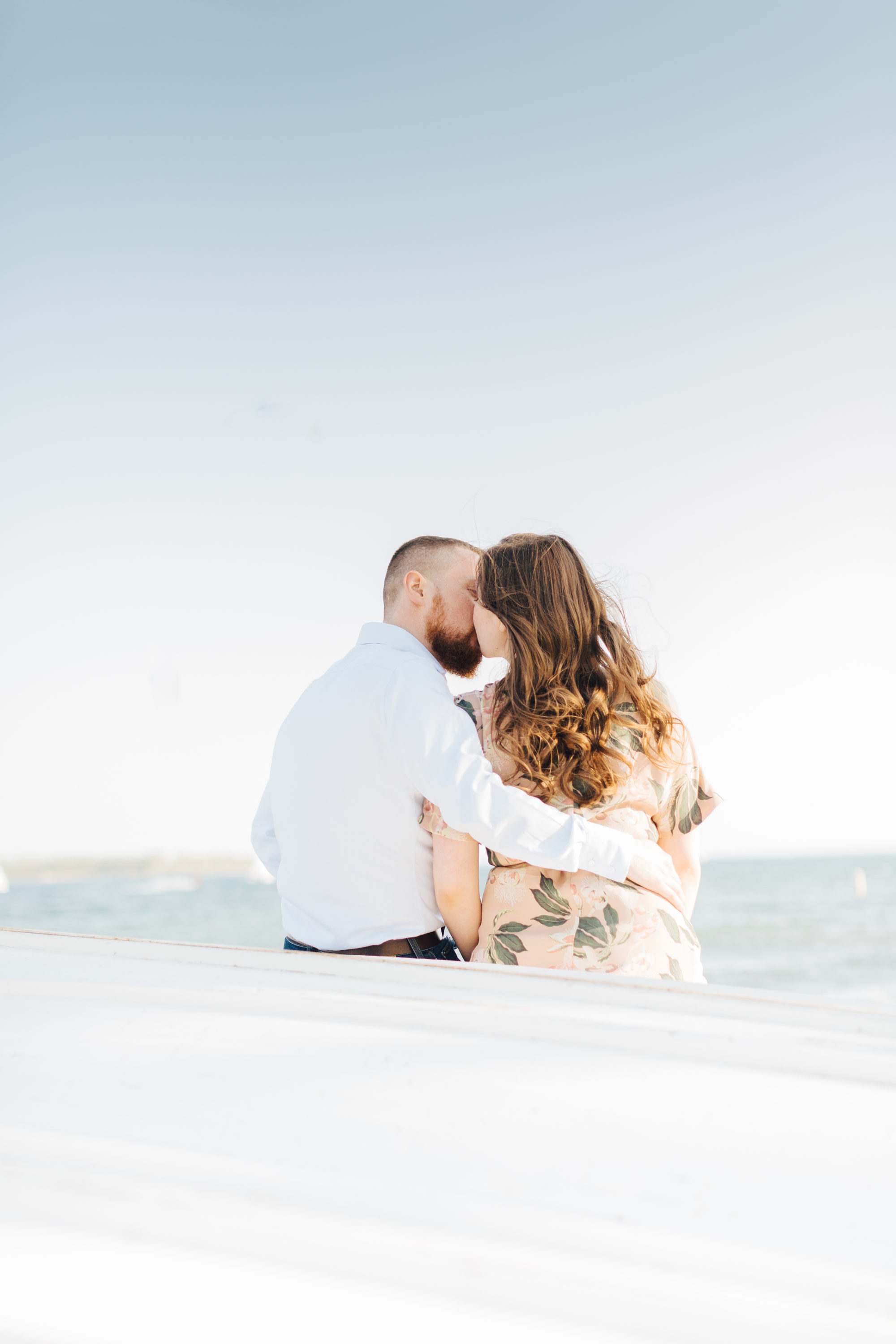 couple kissing at engagement session at cherry beach
