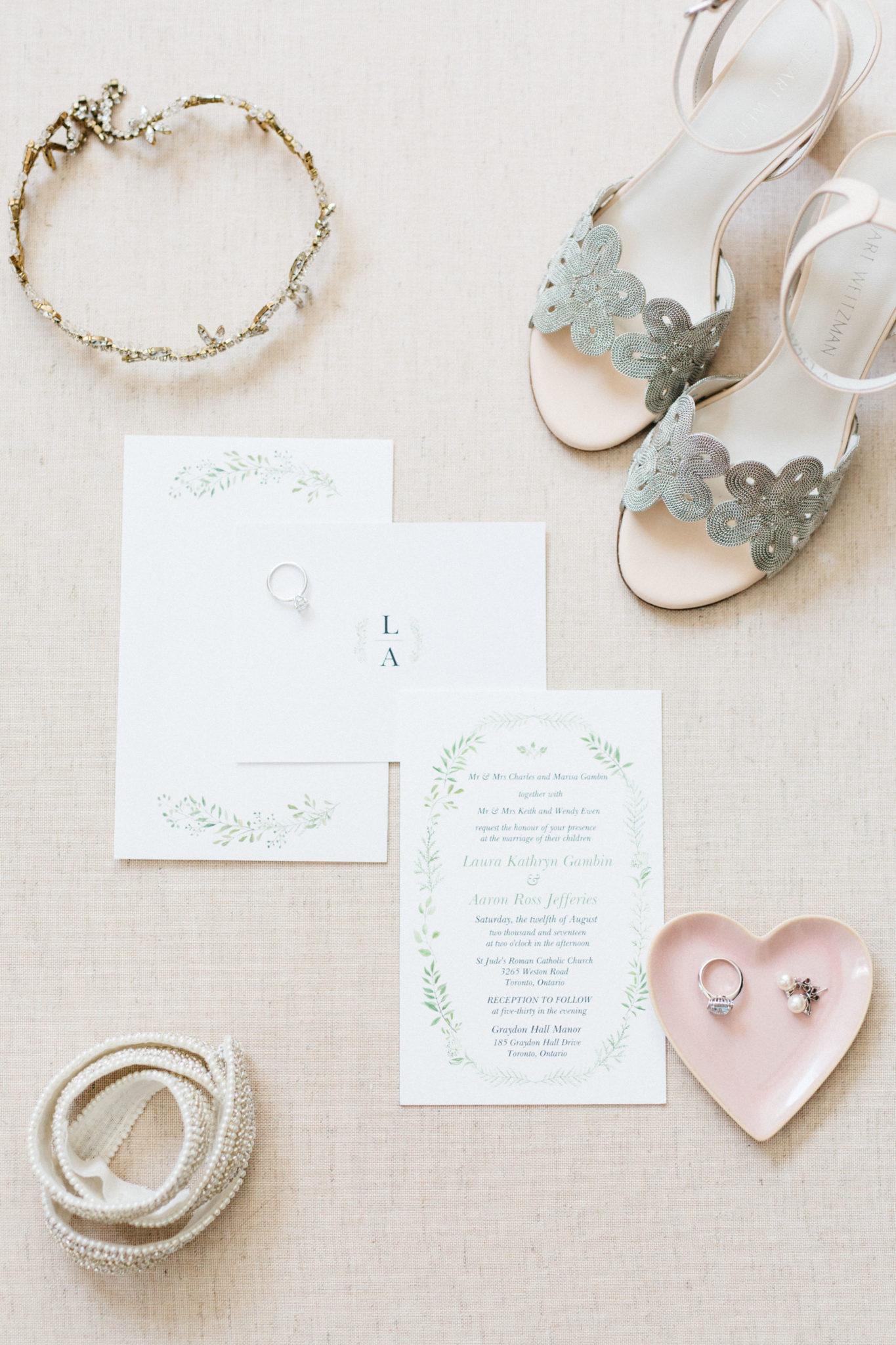 Bride's shoes, rings, belt, and wedding invitation