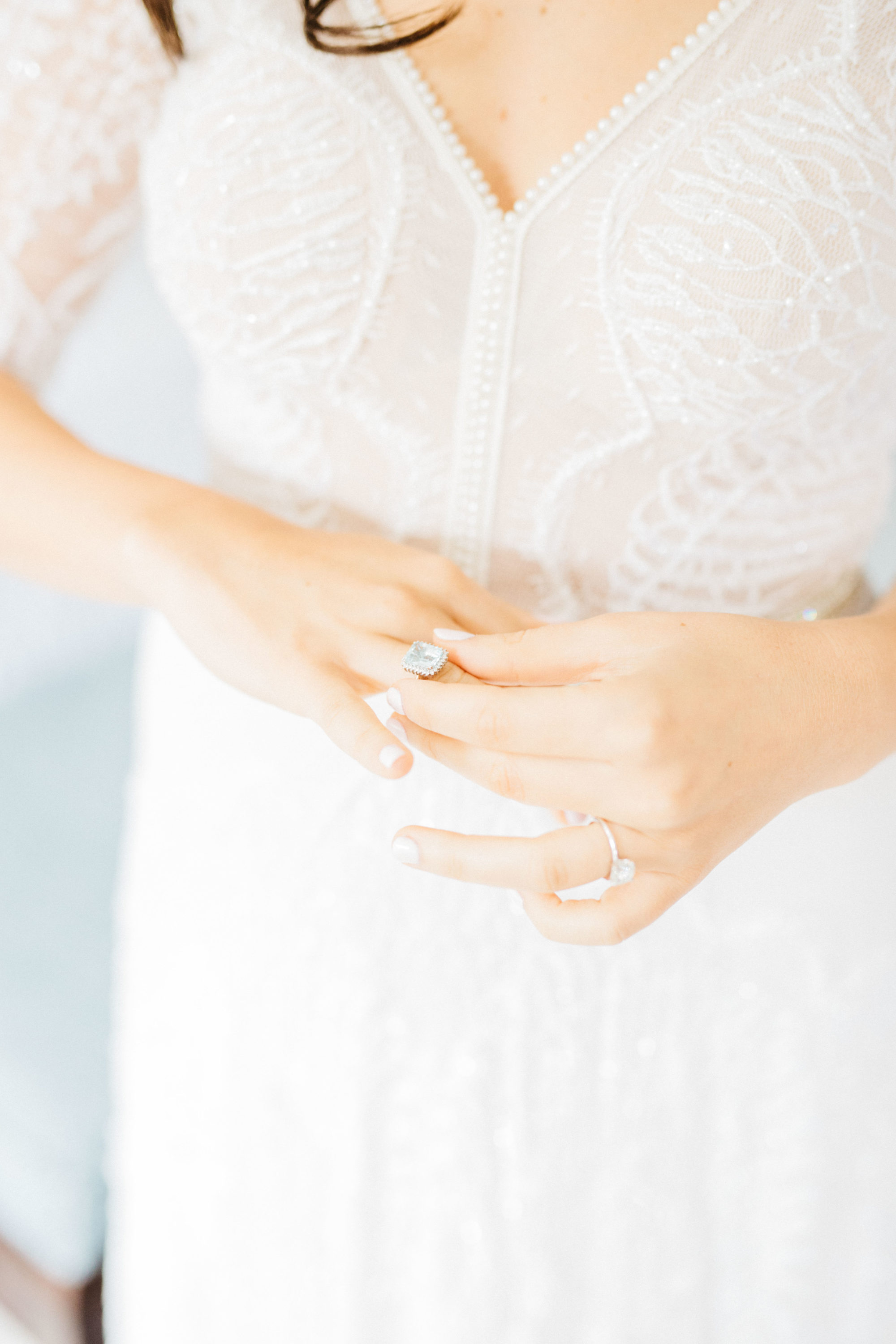 Bride putting ring on