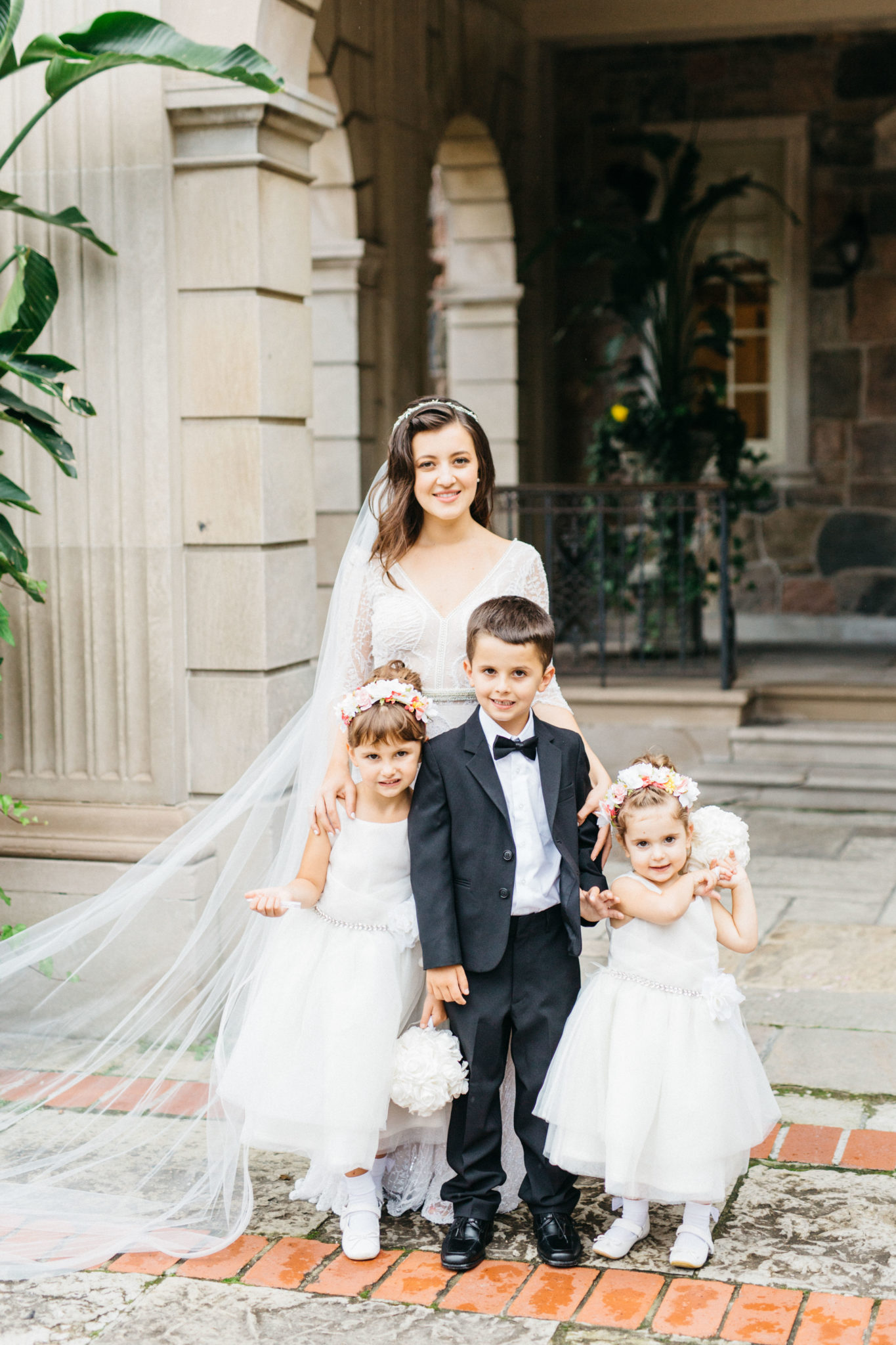 Bride with flower girls and ring boy at Bride and groom at Graydon Hall Manor