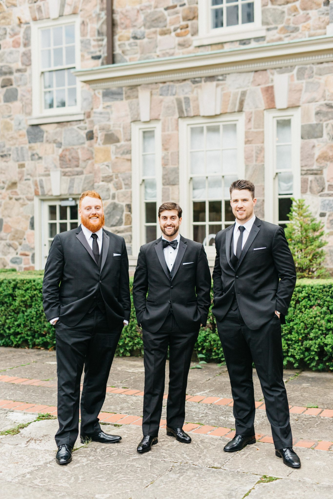Groom with groomsmen outside Graydon Hall Manor