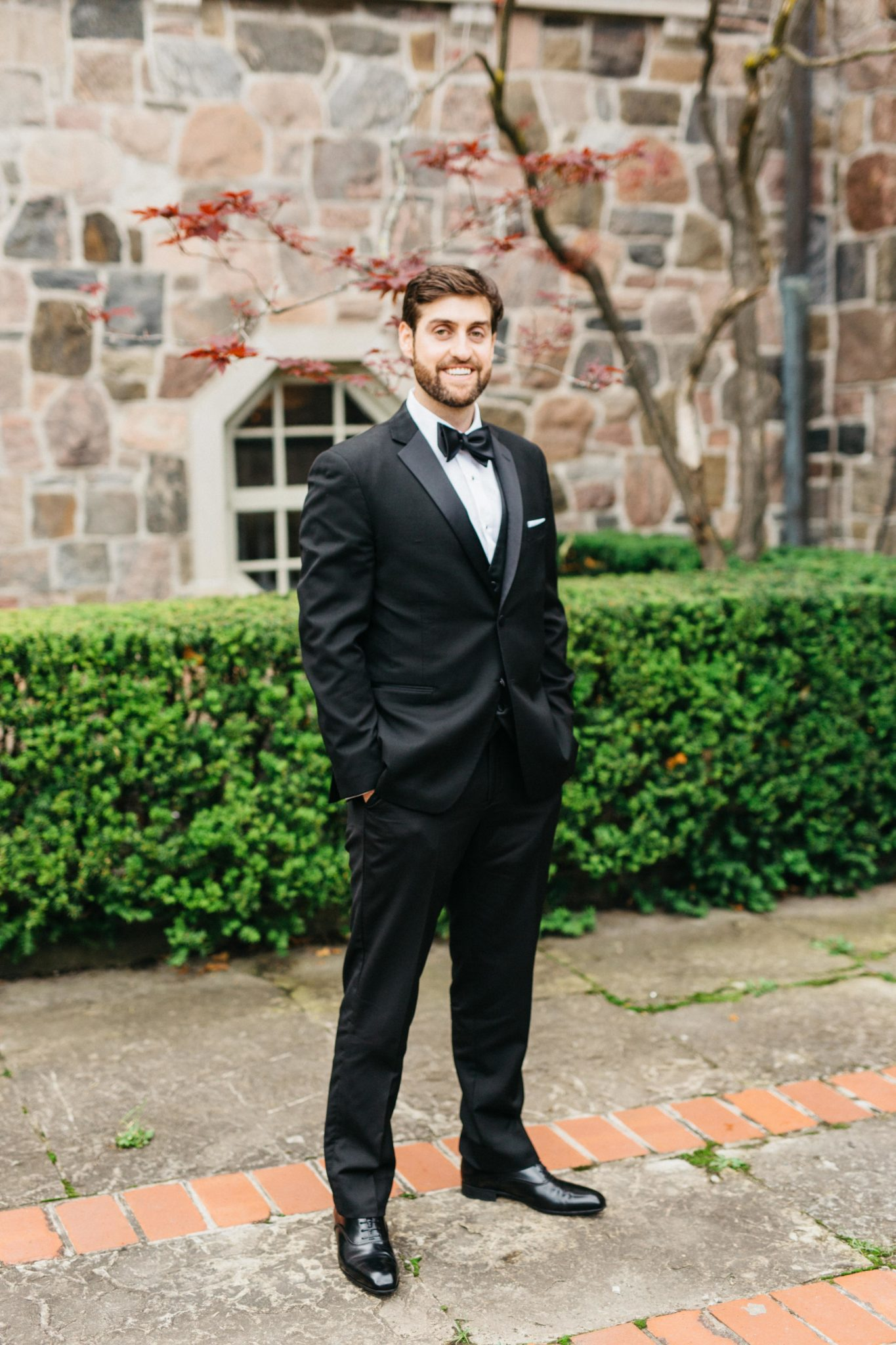 Groom portrait outside of Graydon Hall Manor