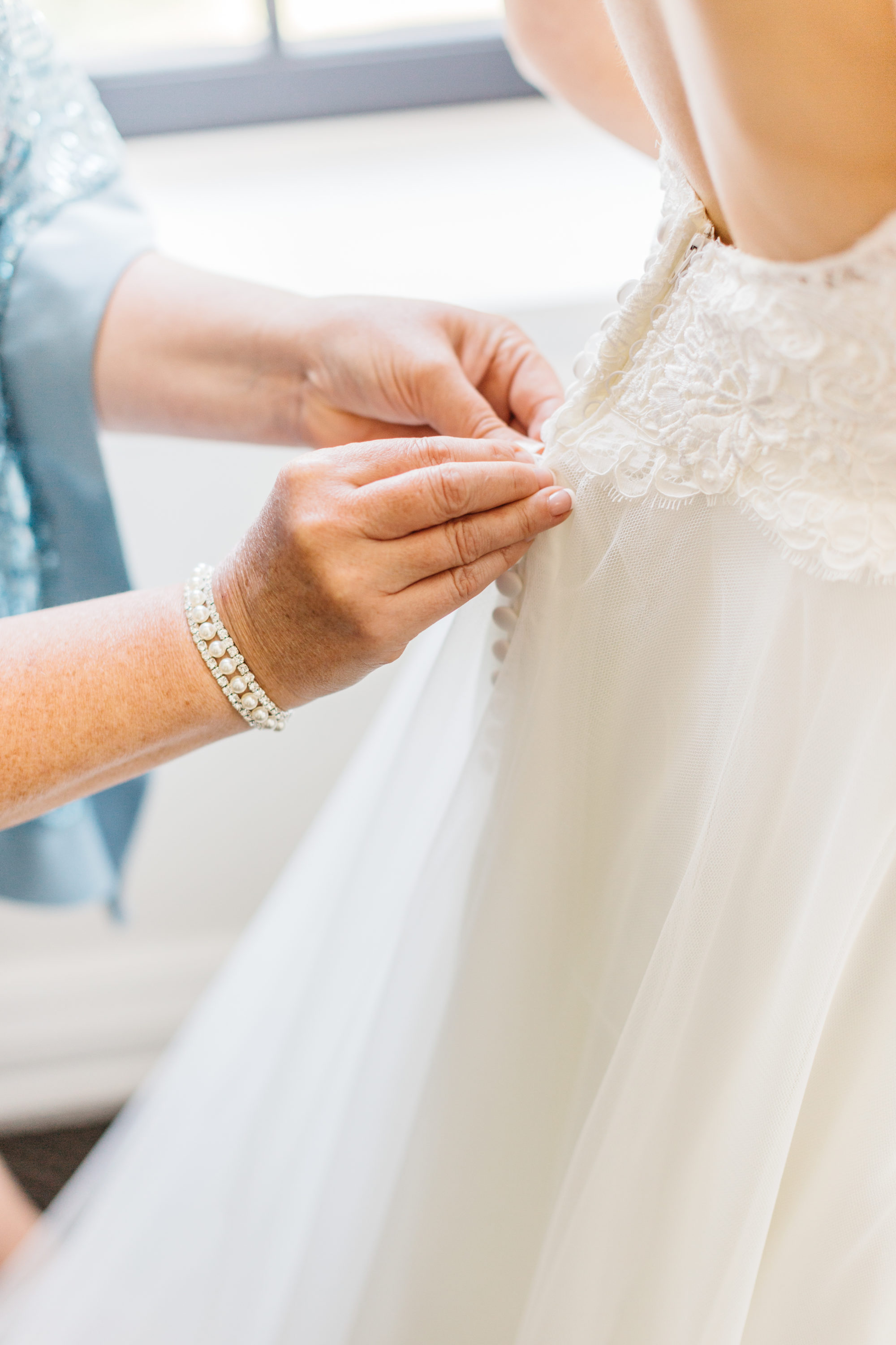 Detail photo of bride getting ready