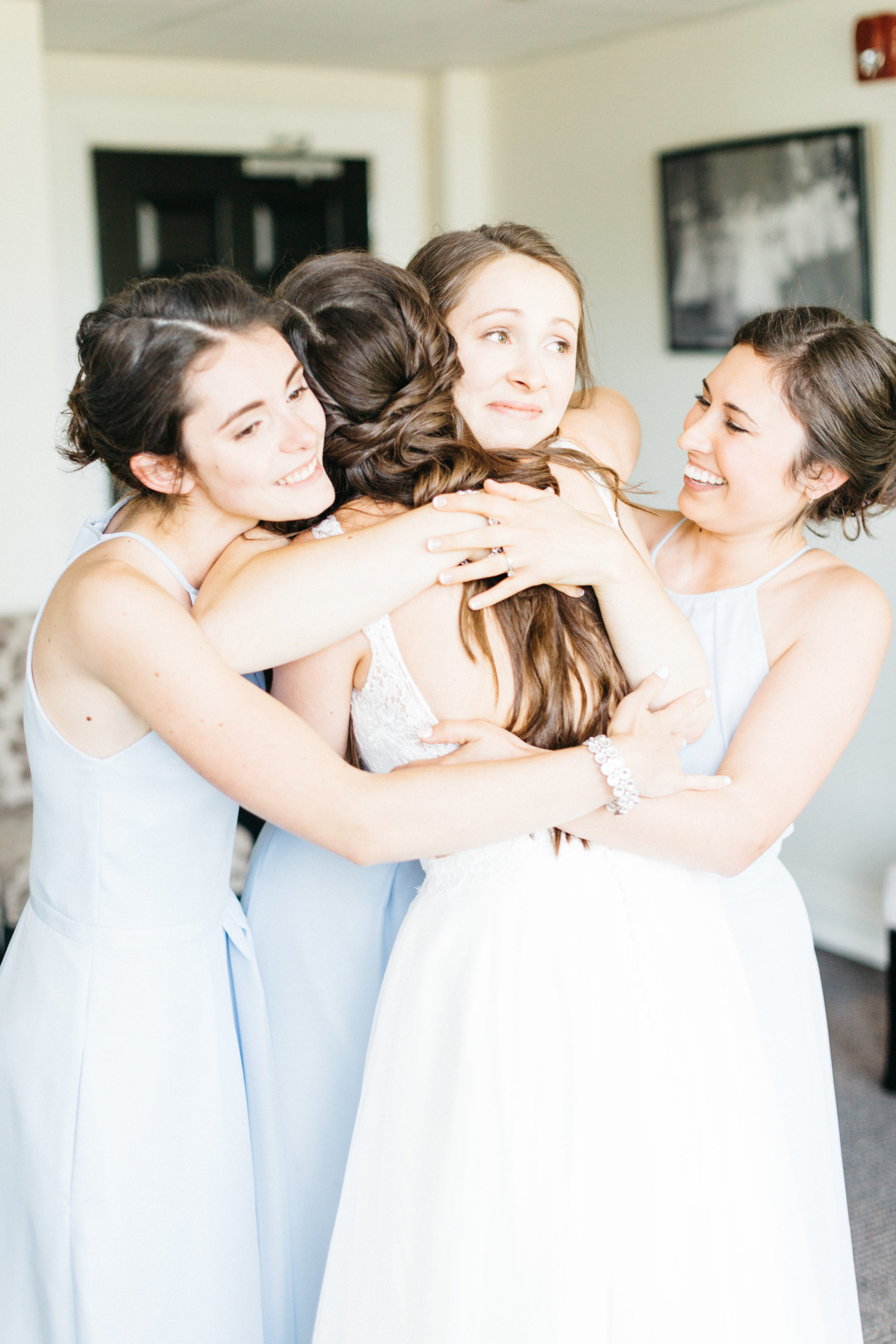 Bride hugging her bridesmaids