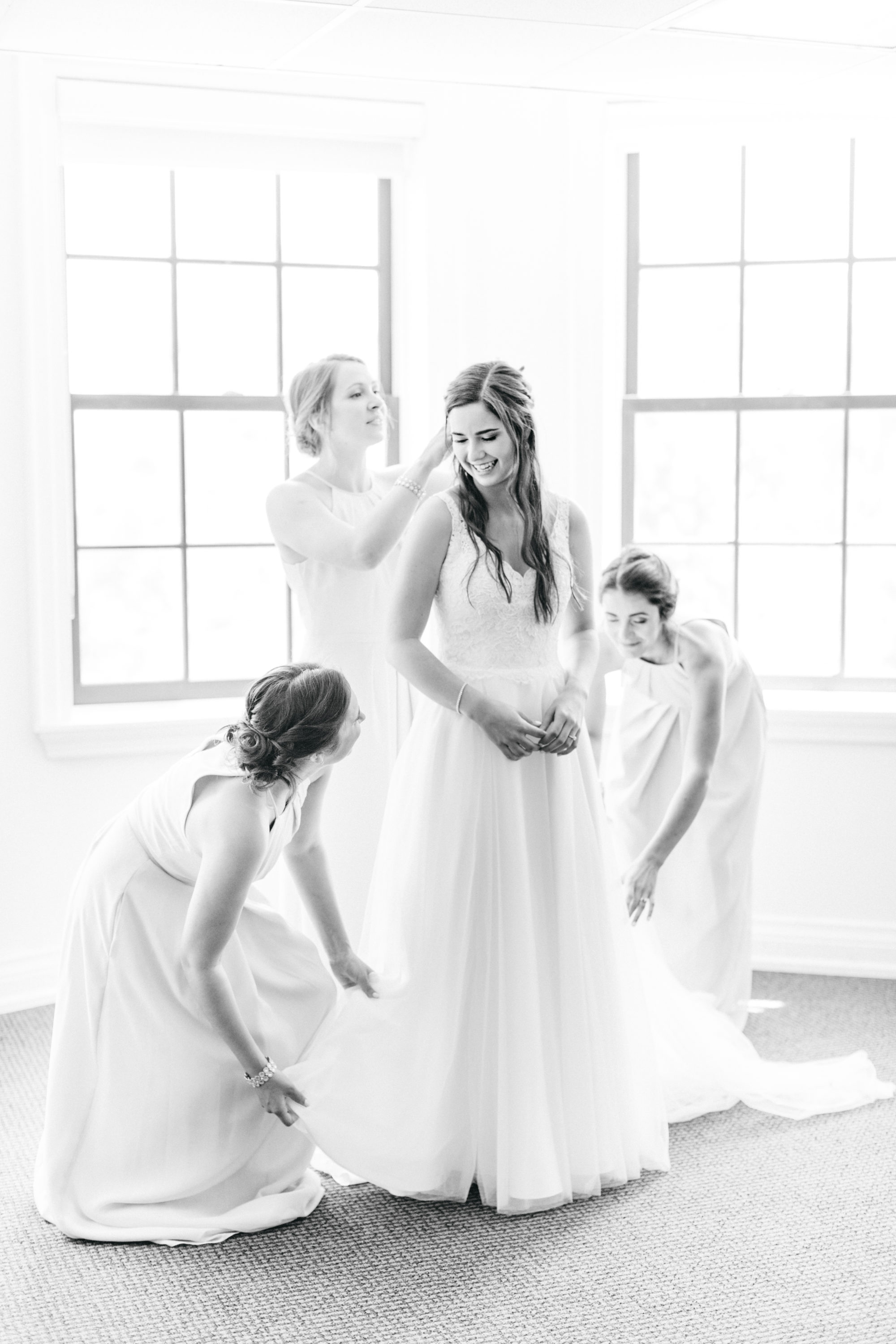 Bridemaids getting bride ready at Harding Waterfront Estate