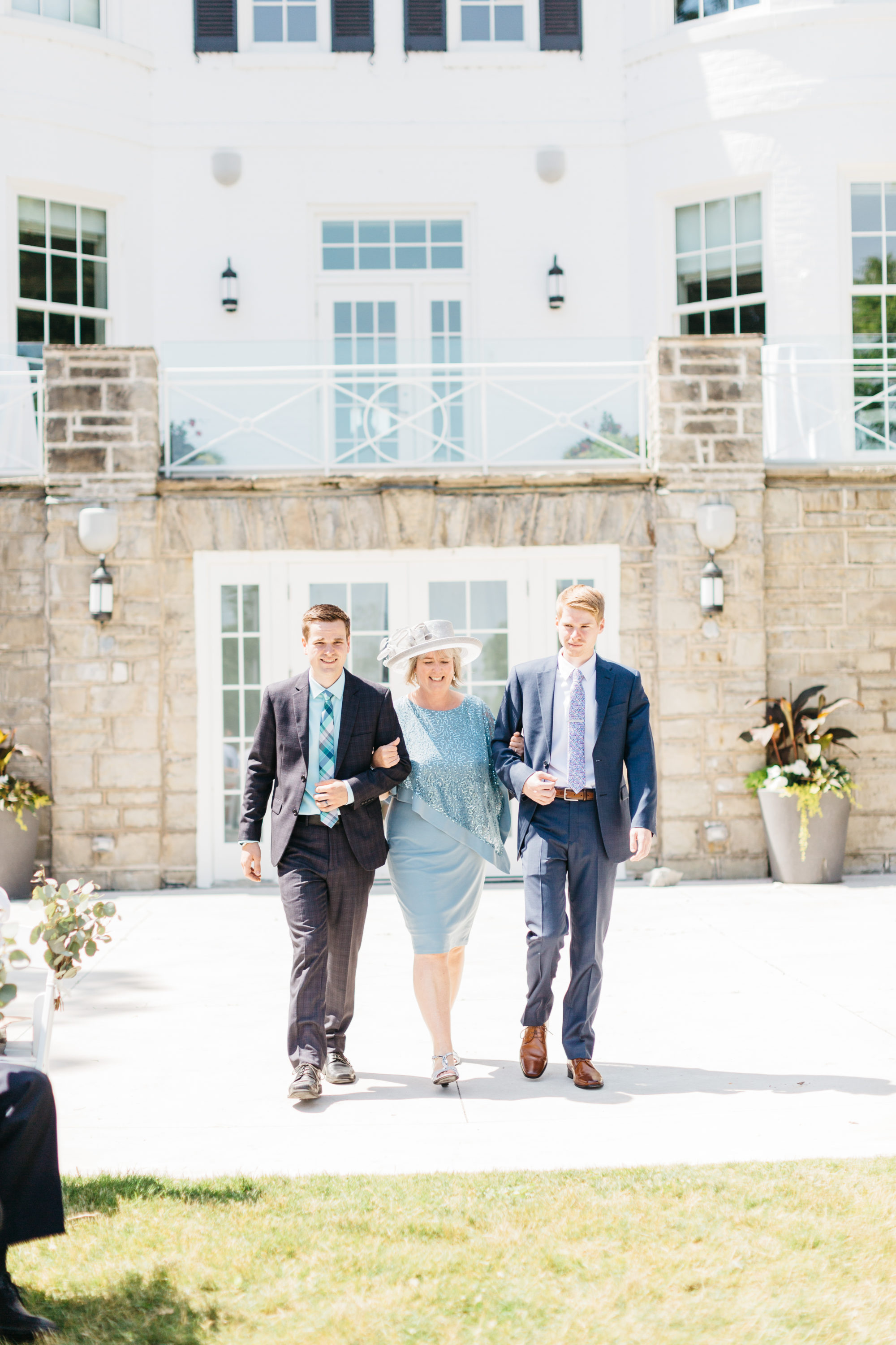 Mom walking down aisle at Harding Waterfront Estate