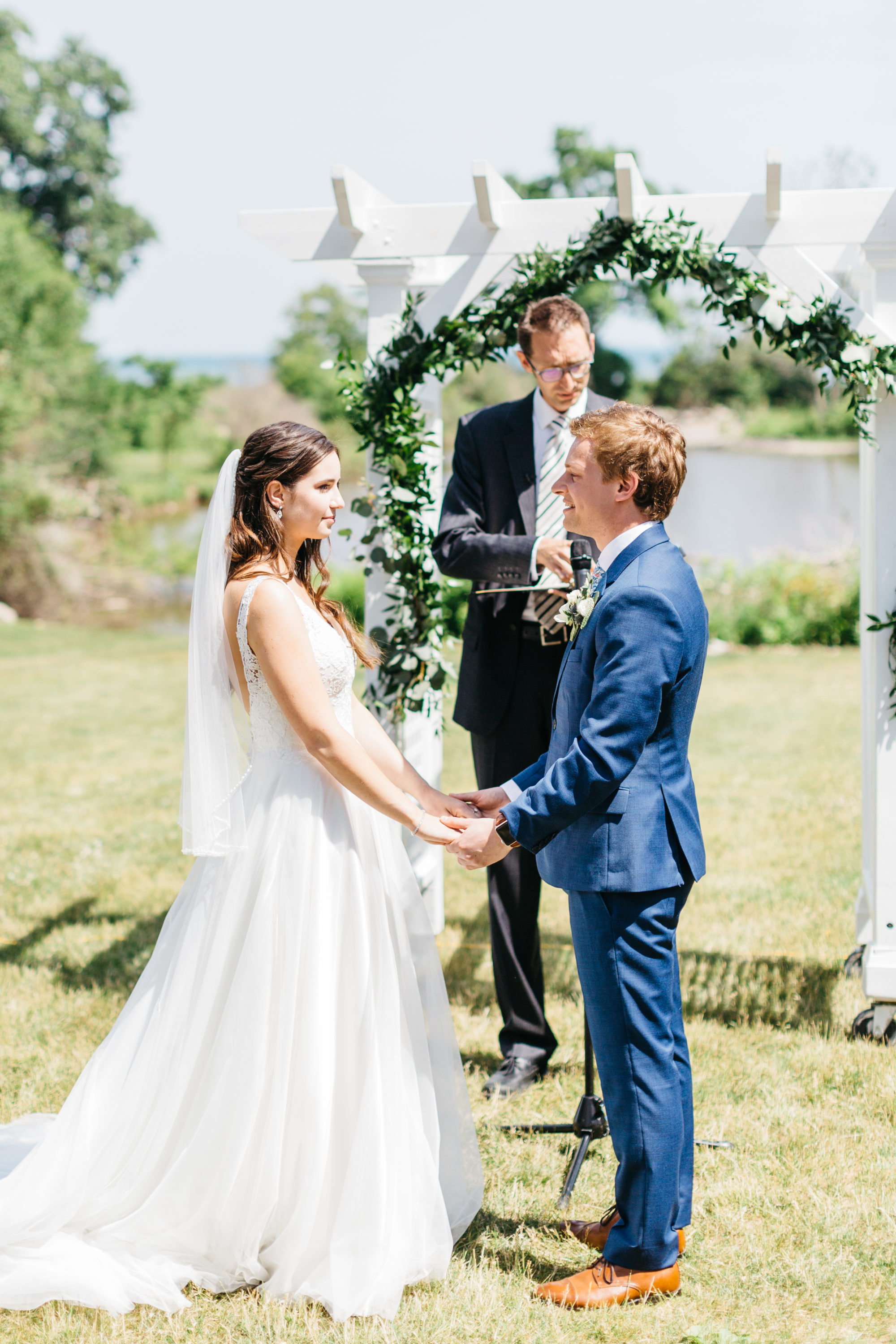 Bride and groom during ceremony at Harding Waterfront Estate