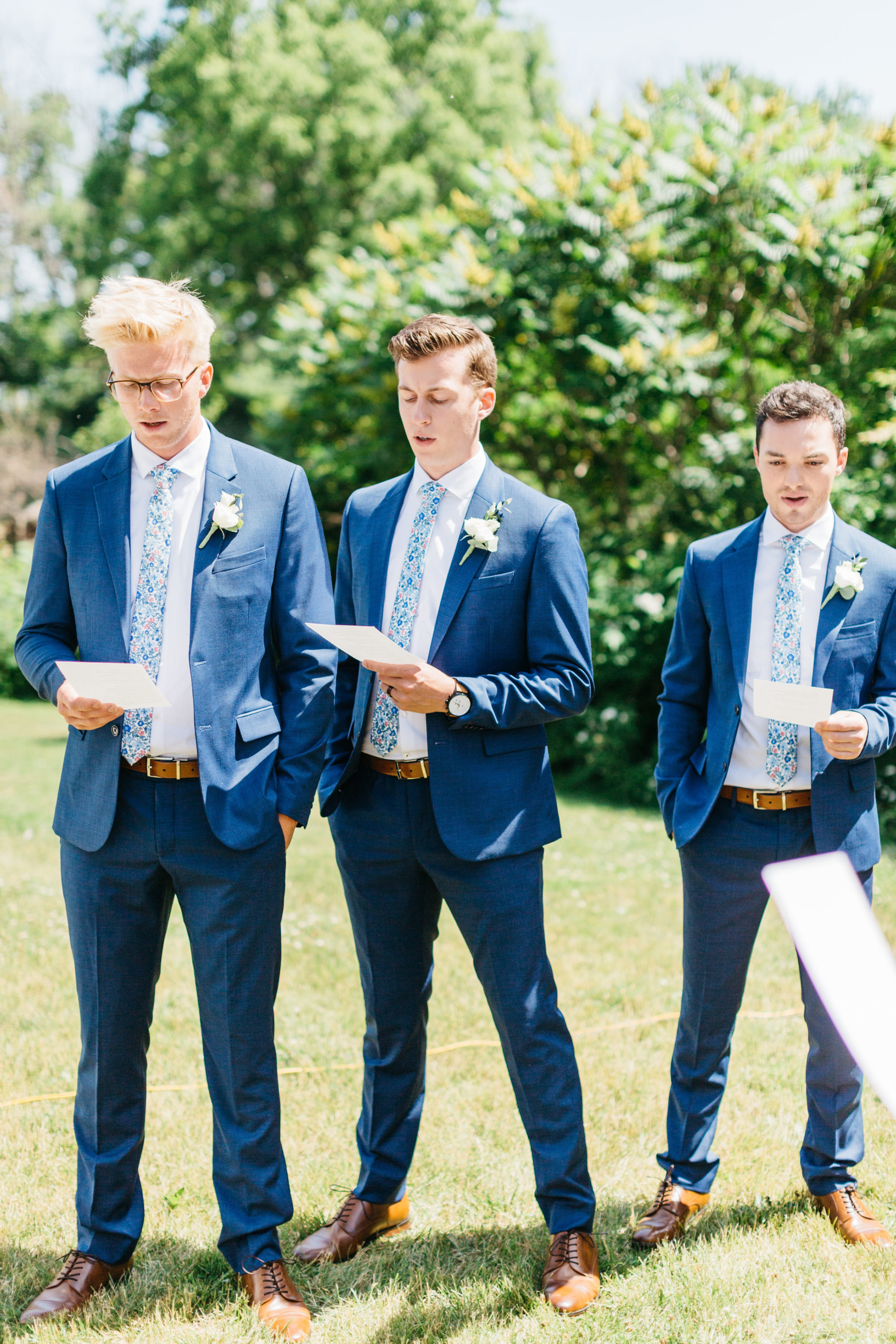 Groomsmen singing during ceremony