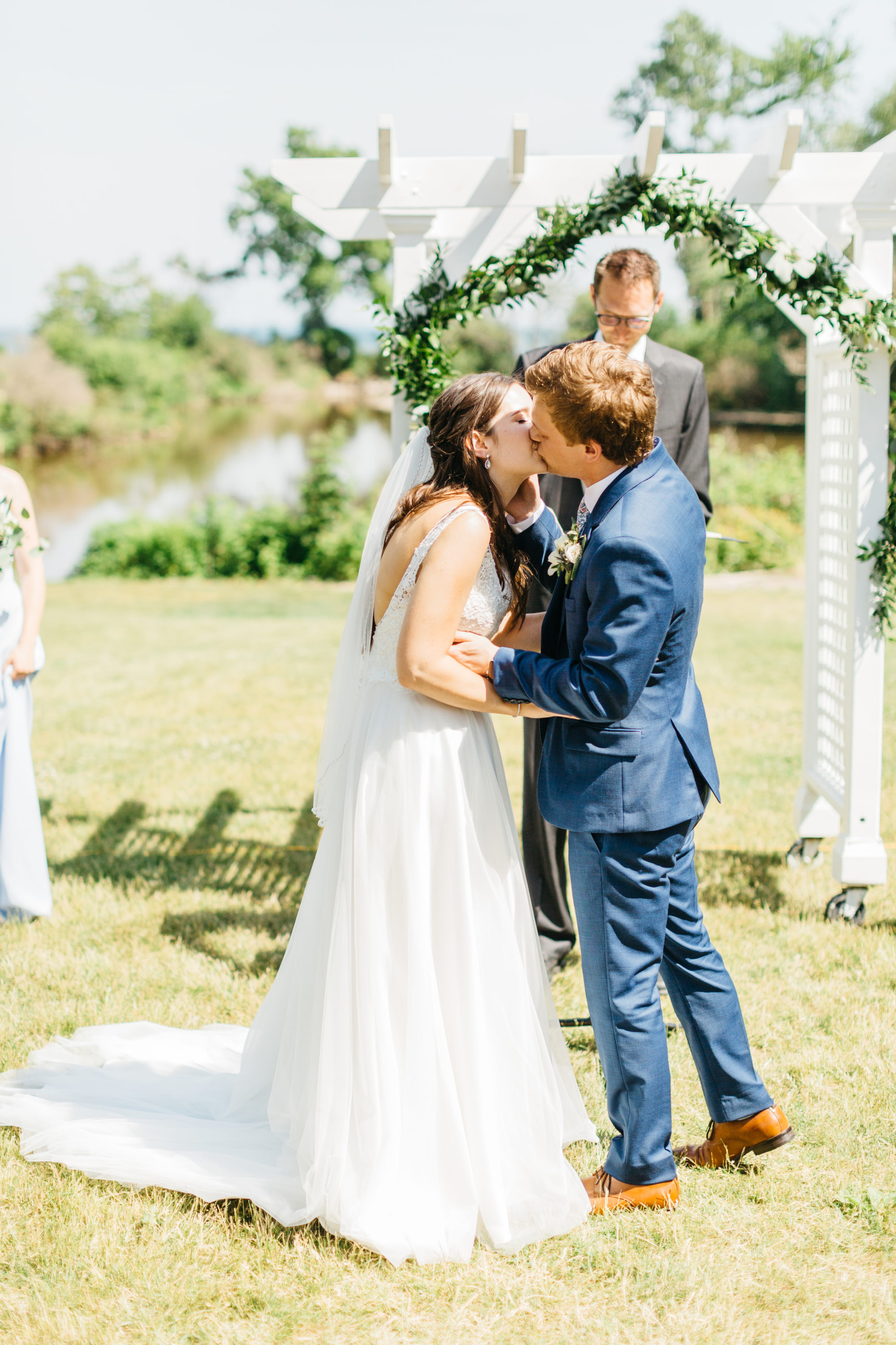 Bride and groom's first kiss at Harding Waterfront Estate