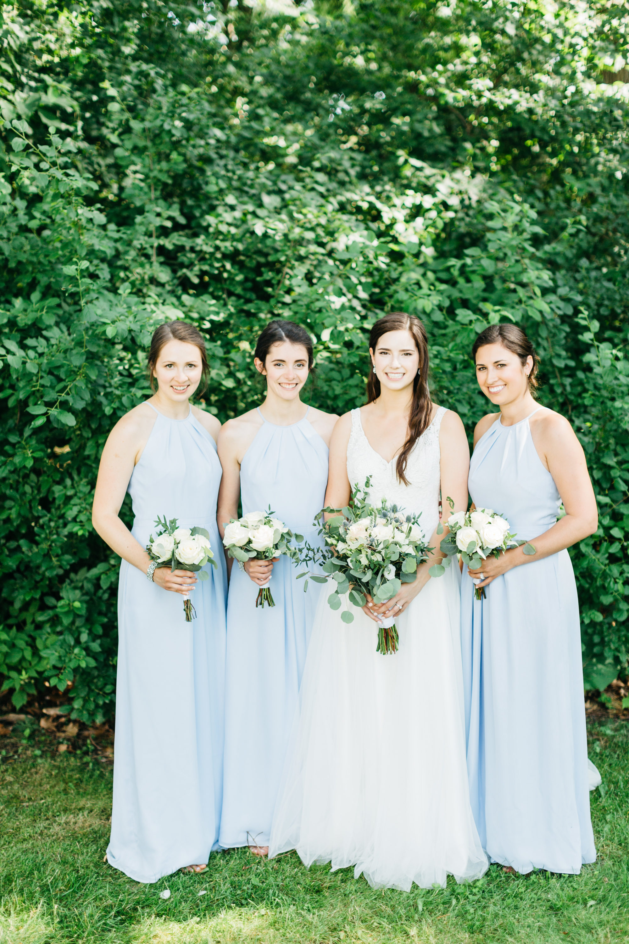 Bride and bridesmaids posing
