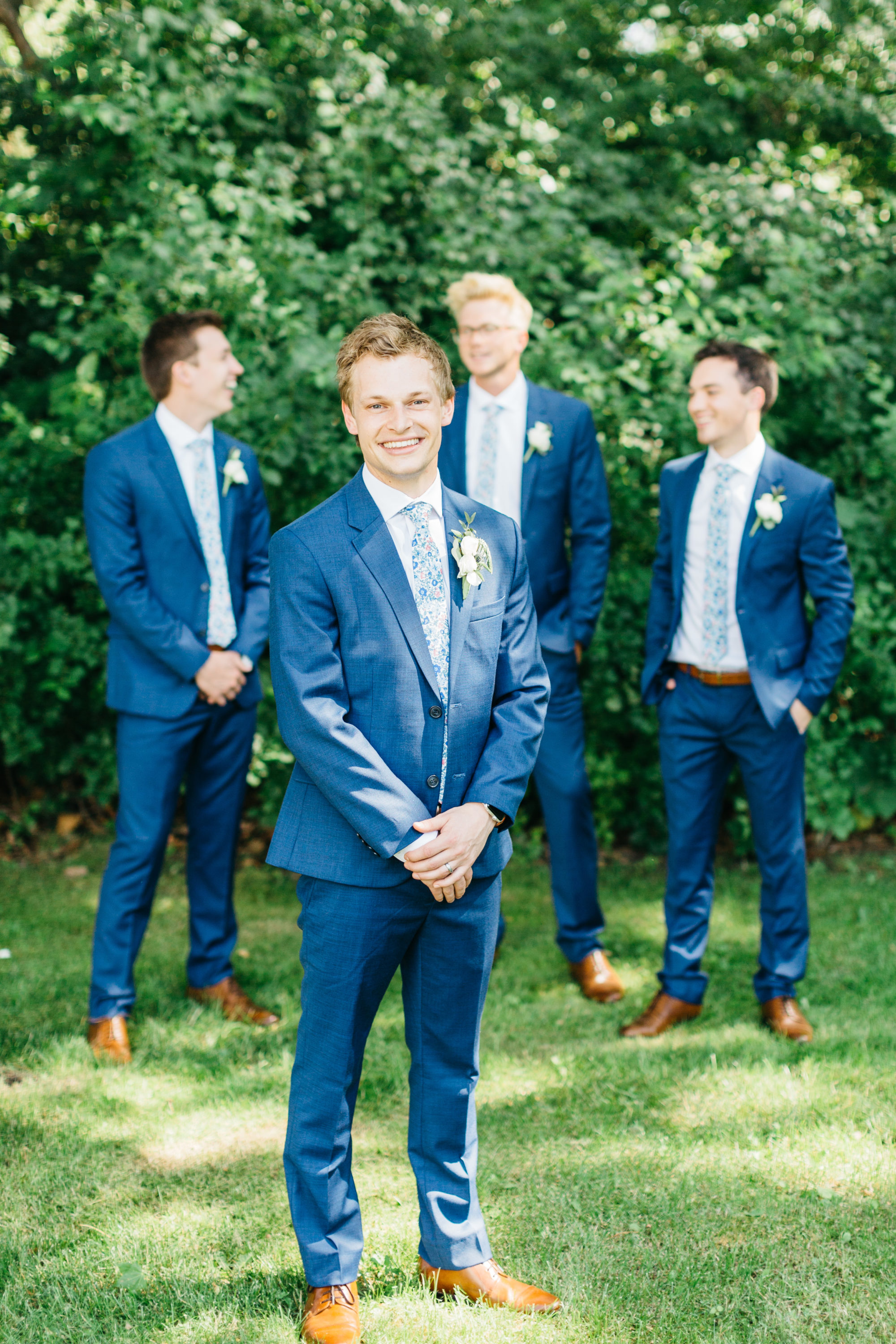 Groom posing with groomsmen at Harding Waterfront Estate