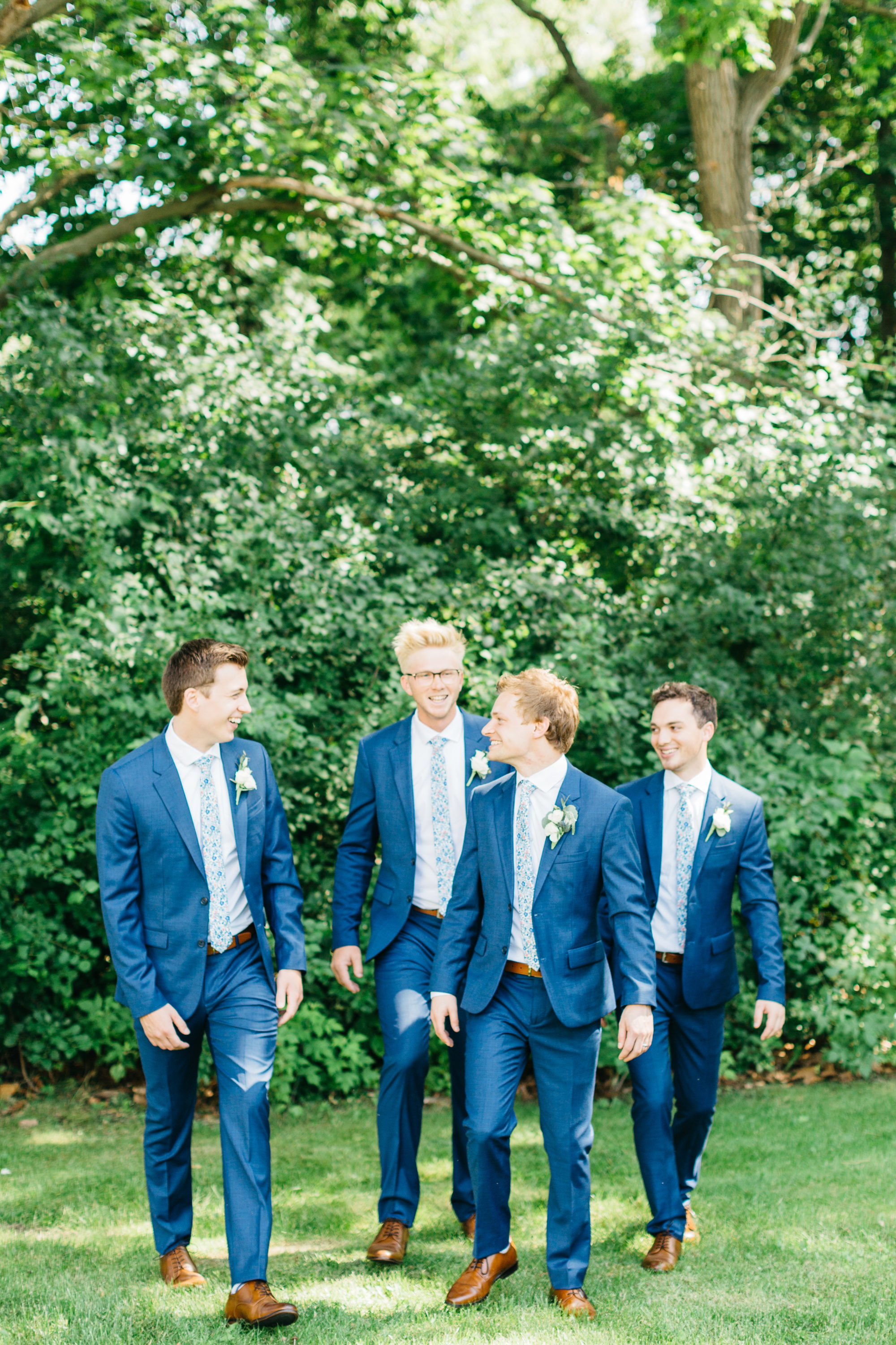 Groom walking with groomsmen