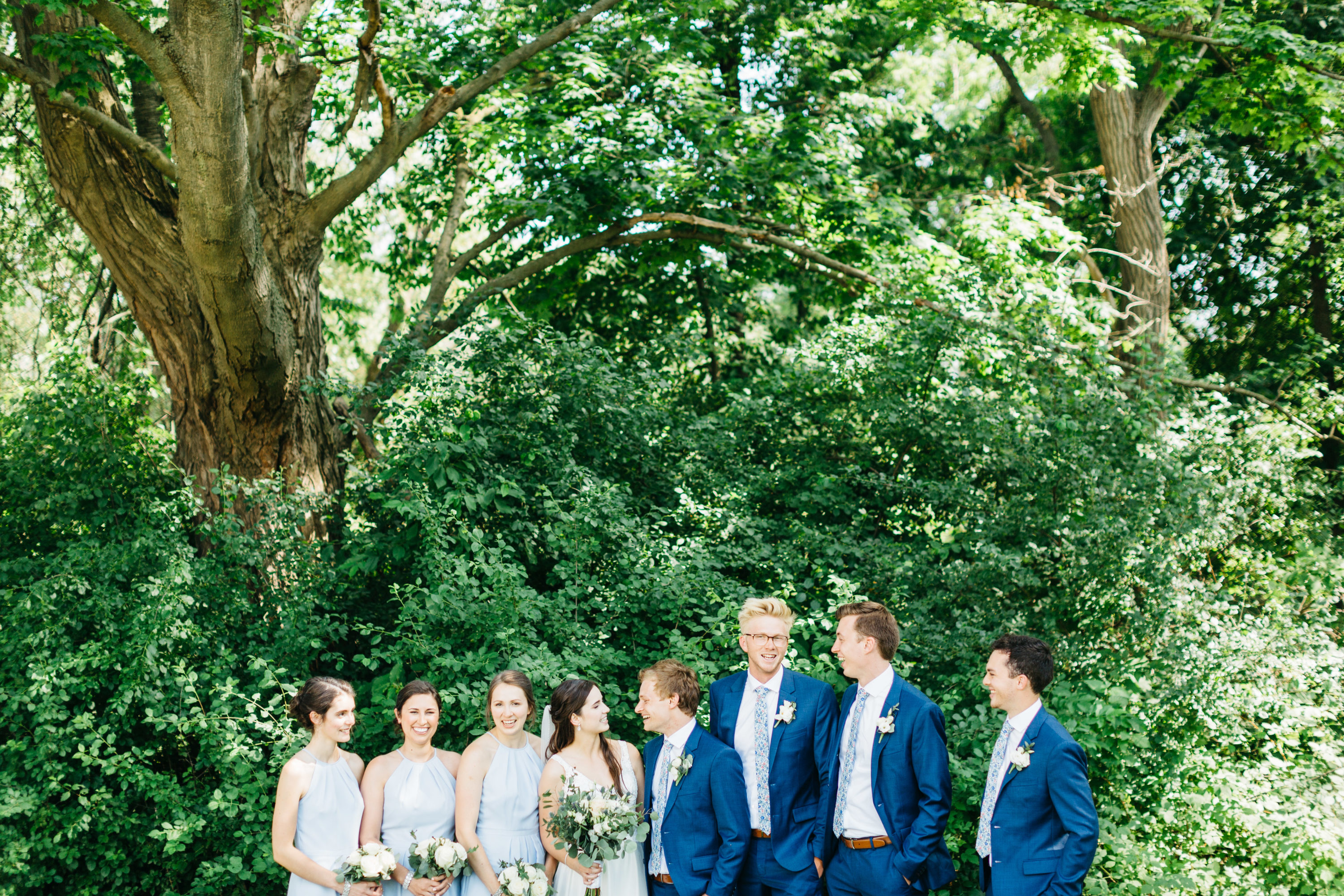 Bridal party laughing with each other