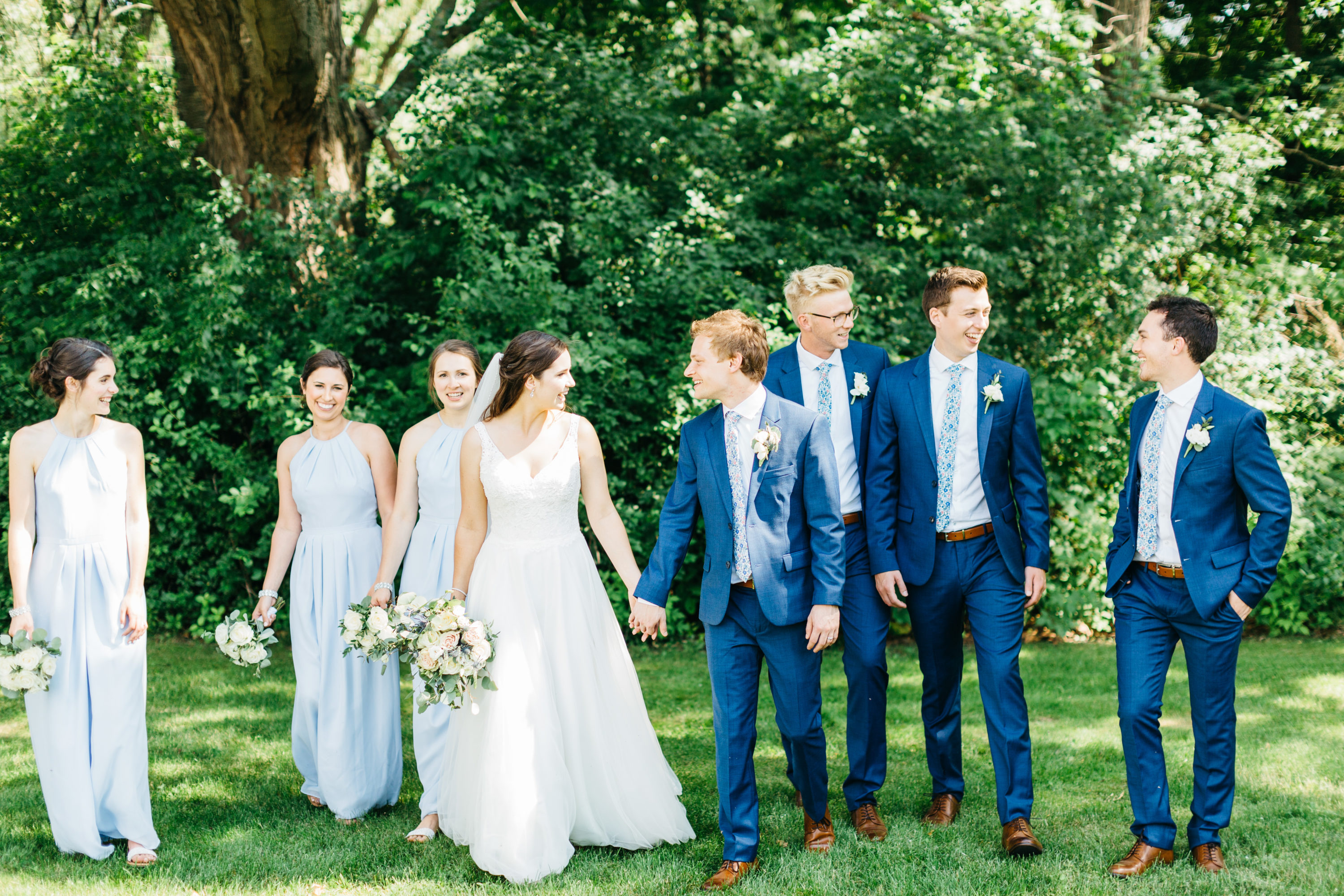 Bride and Groom walking with bridal party at Harding Waterfront Estate