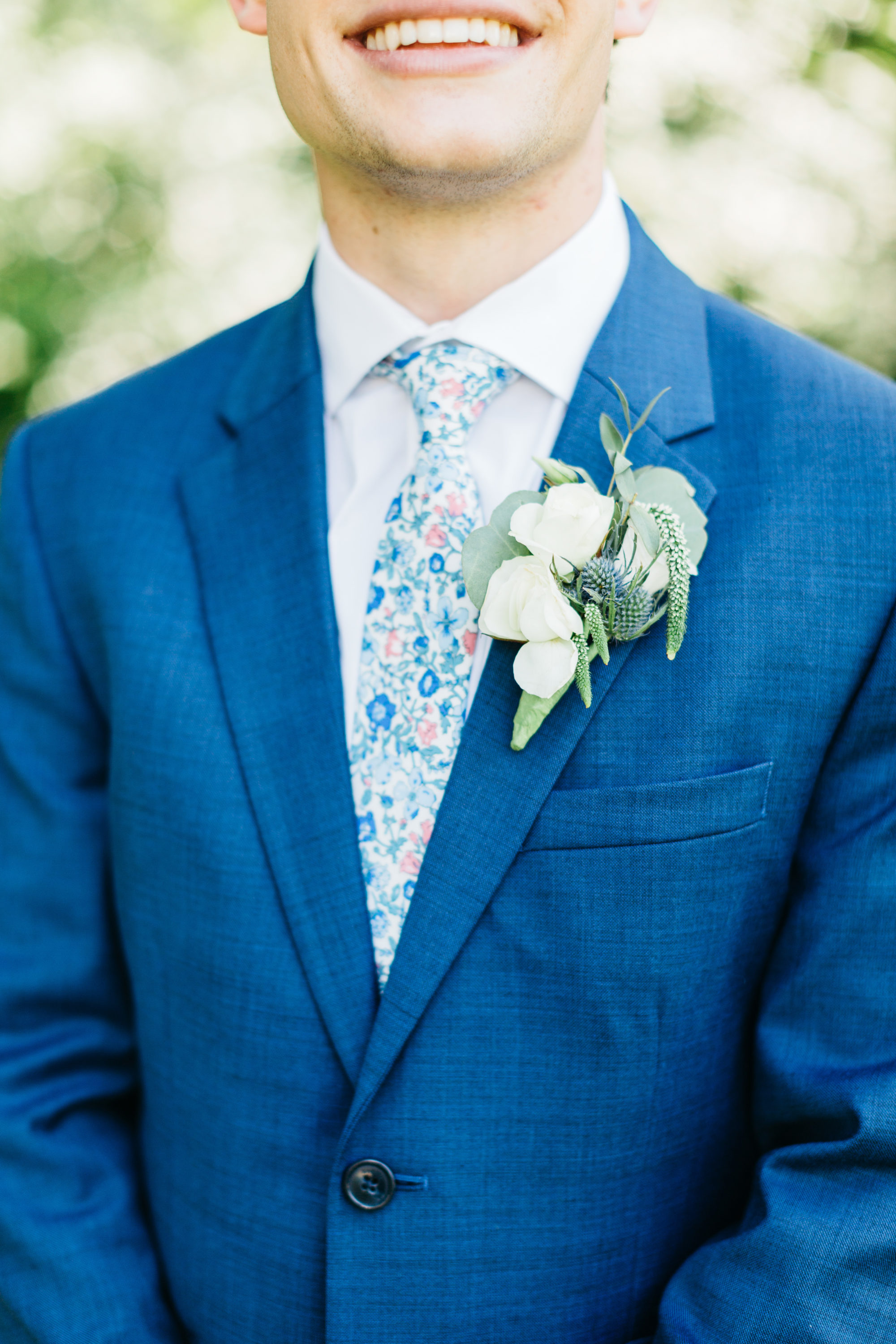Groom boutonniere detail photo