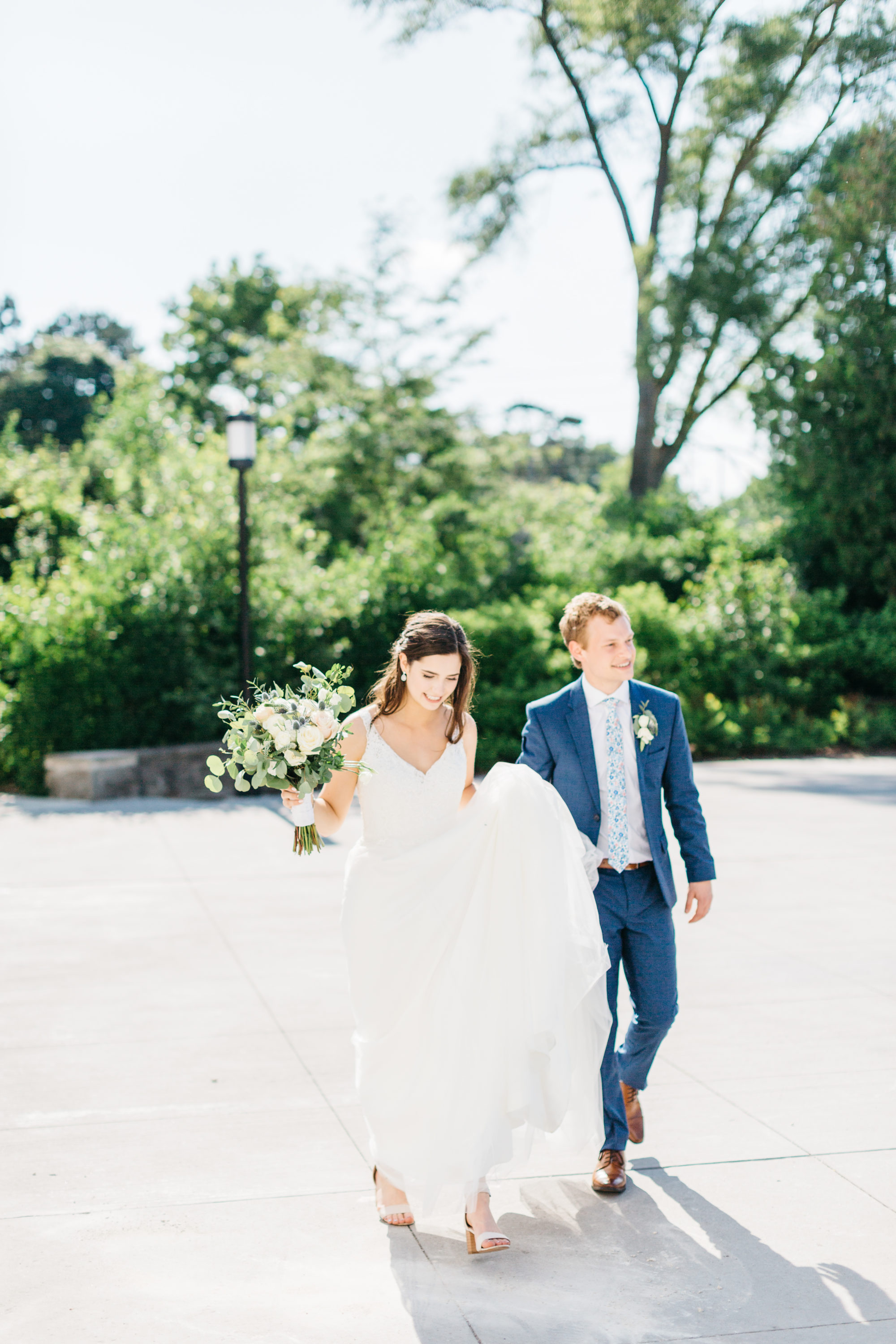 Bride and groom walking on driveway at Harding Waterfront Estate Wedding
