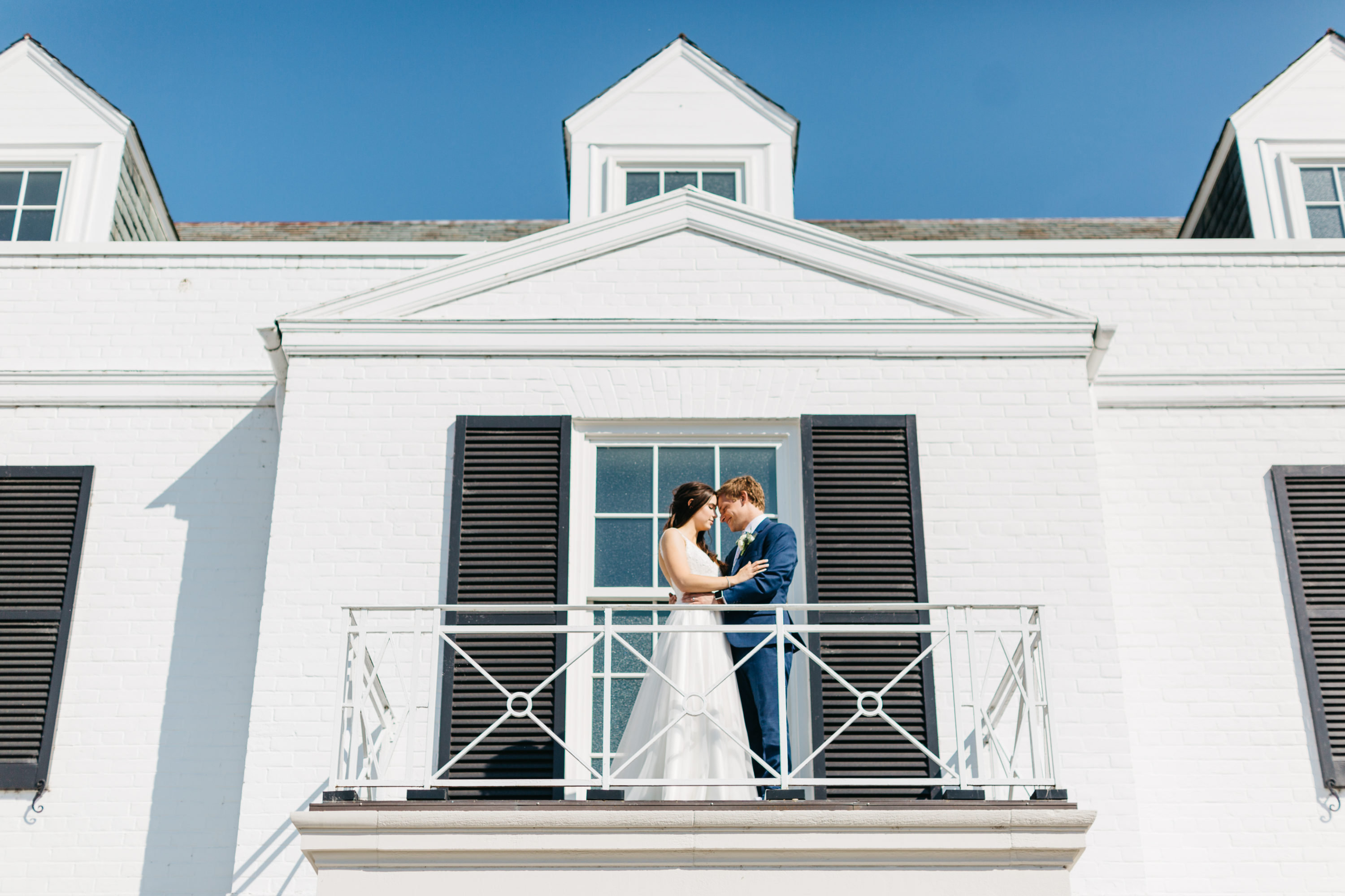 Bride and groom cuddling on Harding Waterfront Estate balcony