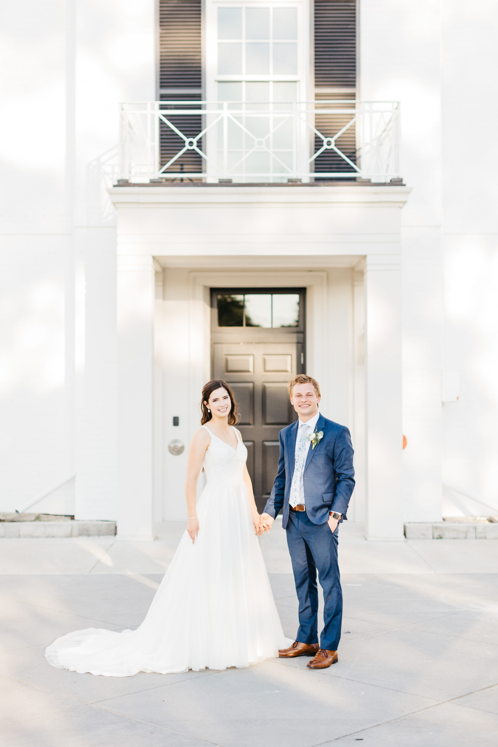 Bride and groom in front of front doors at Harding Waterfront Estate