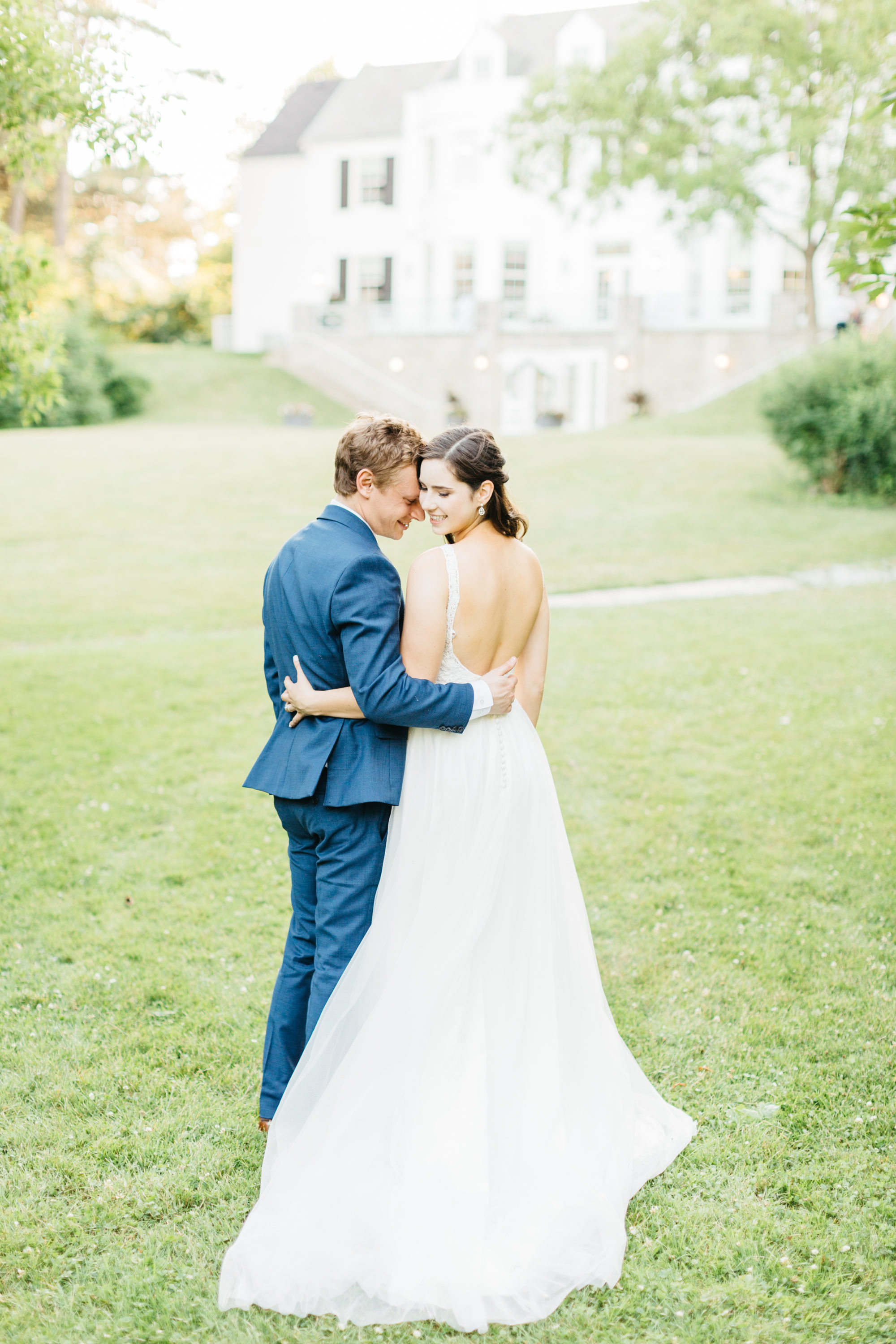 Bride and groom in backyard at Harding Waterfront Estate