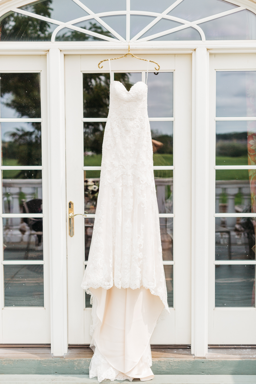 Dress hanging outside at Bride getting ready at Riverbend Inn