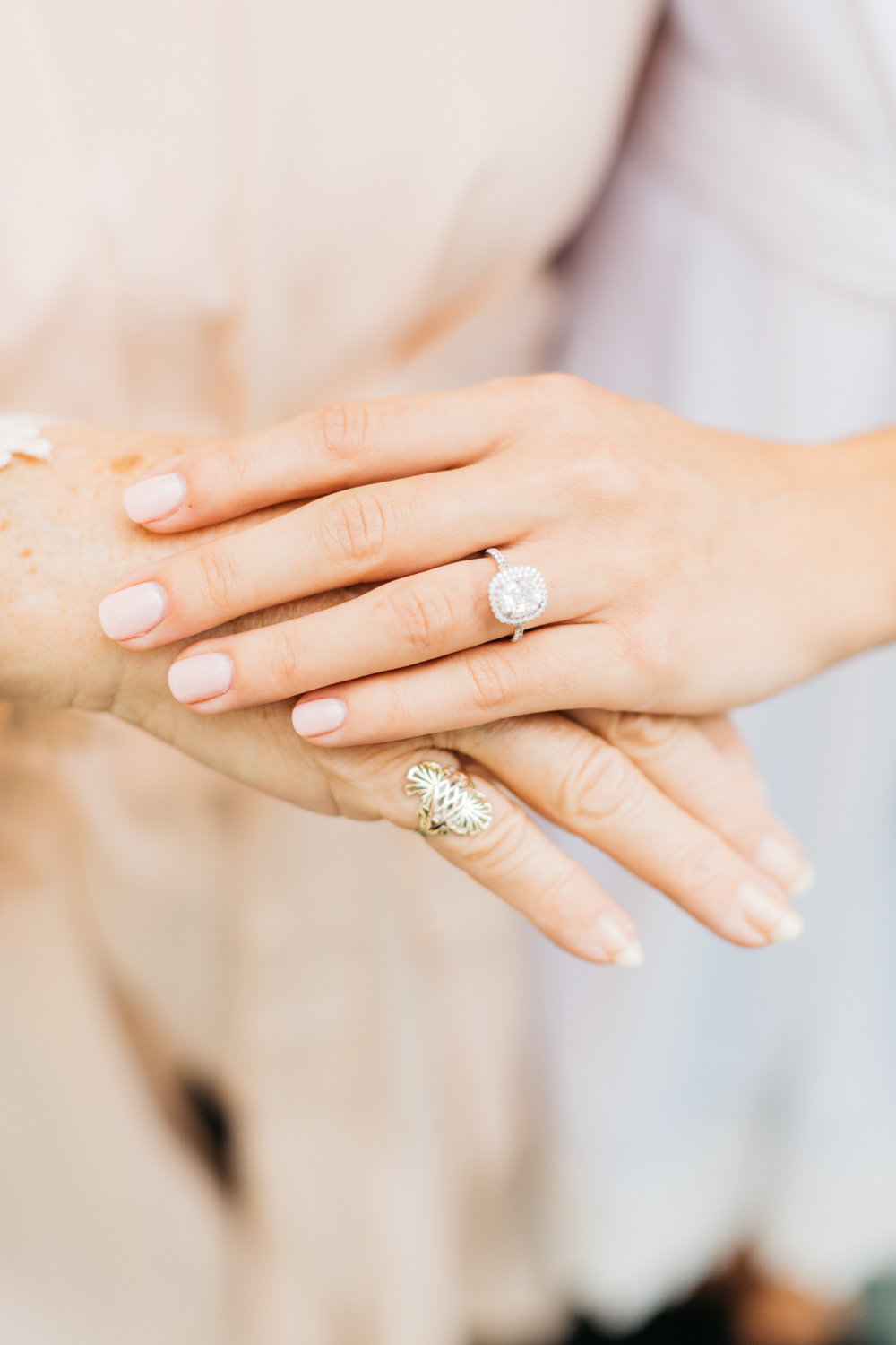 Bride and grandma's hands with rings