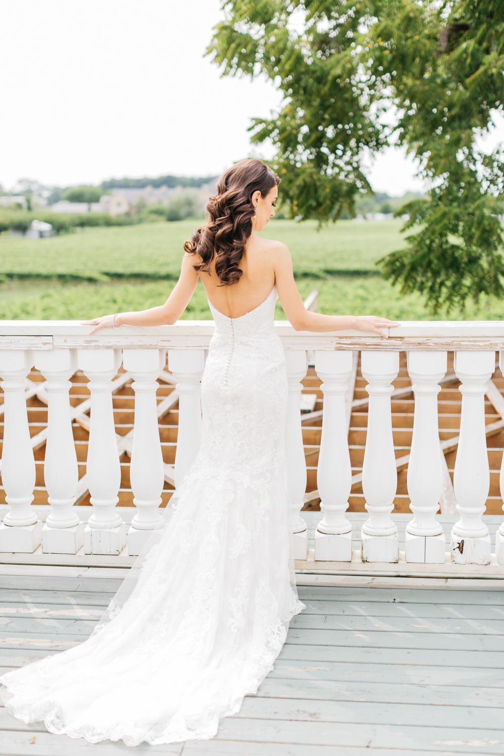 Bride looking at vineyard at Riverbend Inn