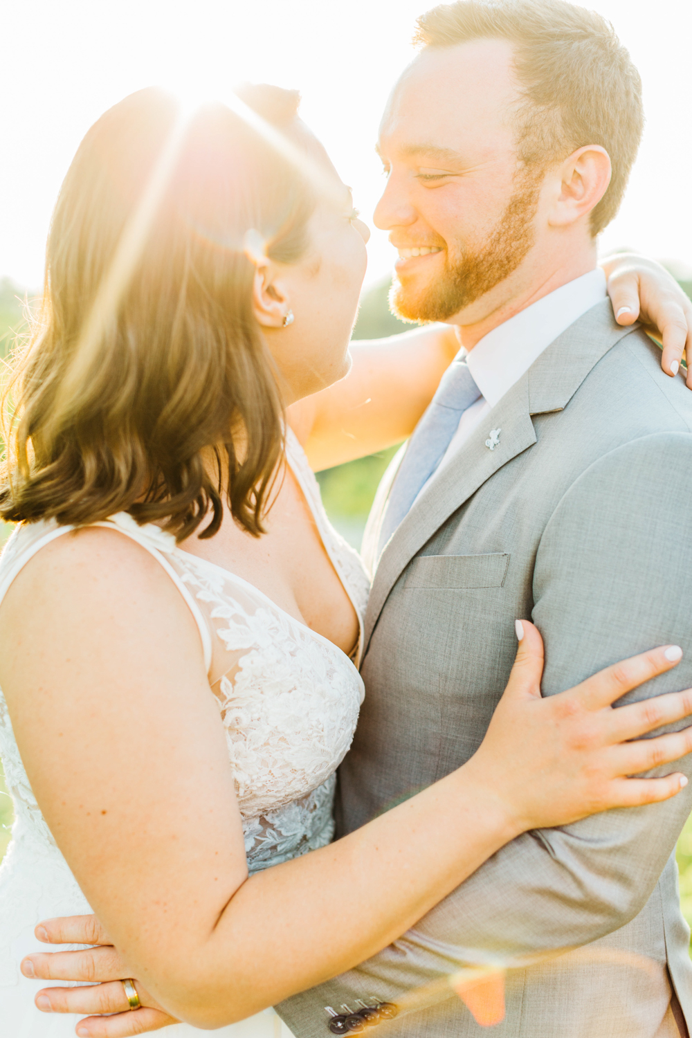 Bride and groom laughing at sunset at Stonewall Estates in St. Catherines