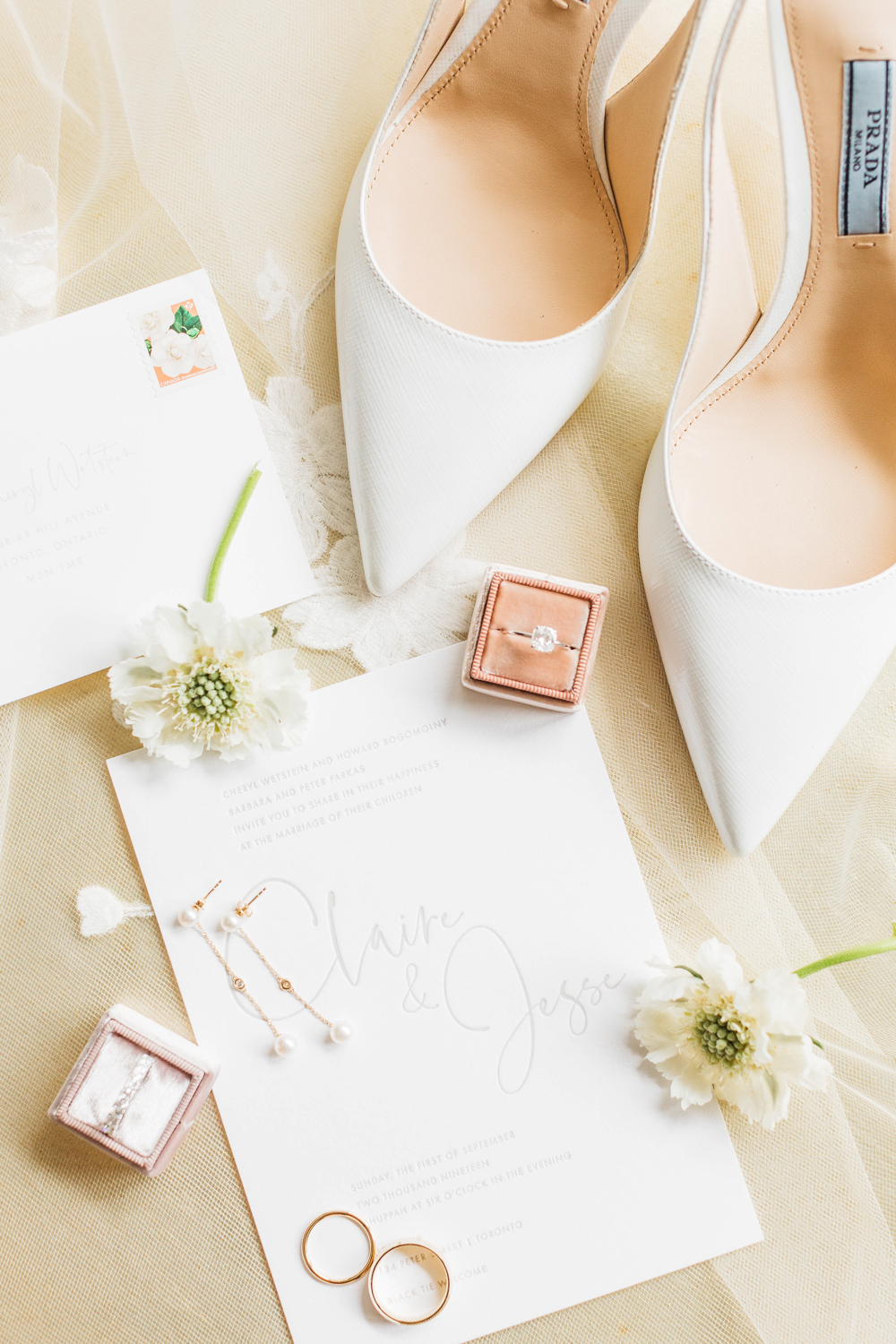 Wedding invitation, wedding rings and bride shoes shot in Toronto
