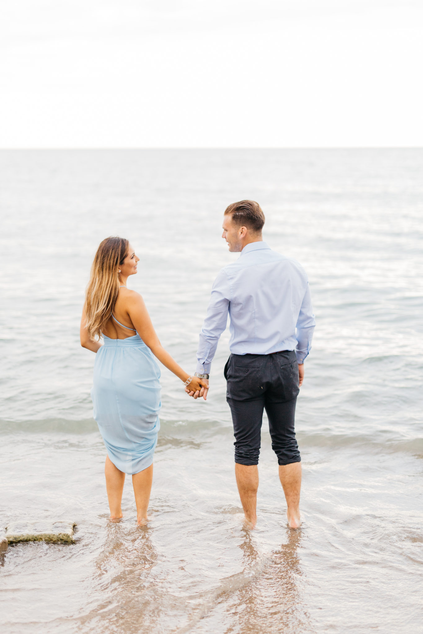 Couple in water at Scarborough Bluffs