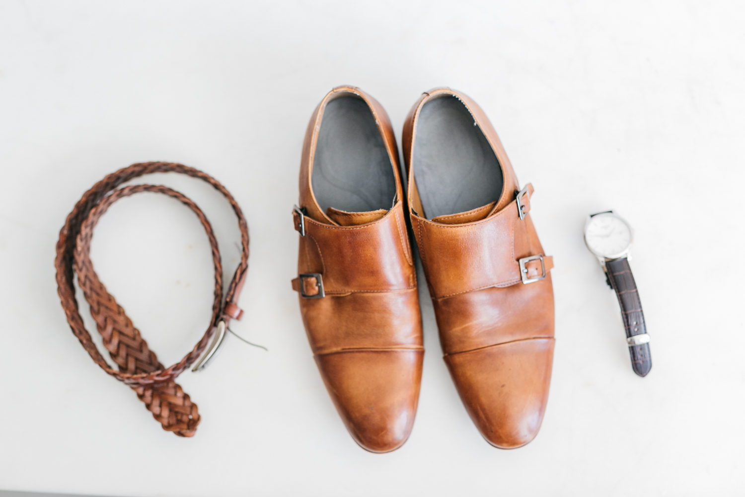 Groom's shoots belt and watch for his destination wedding