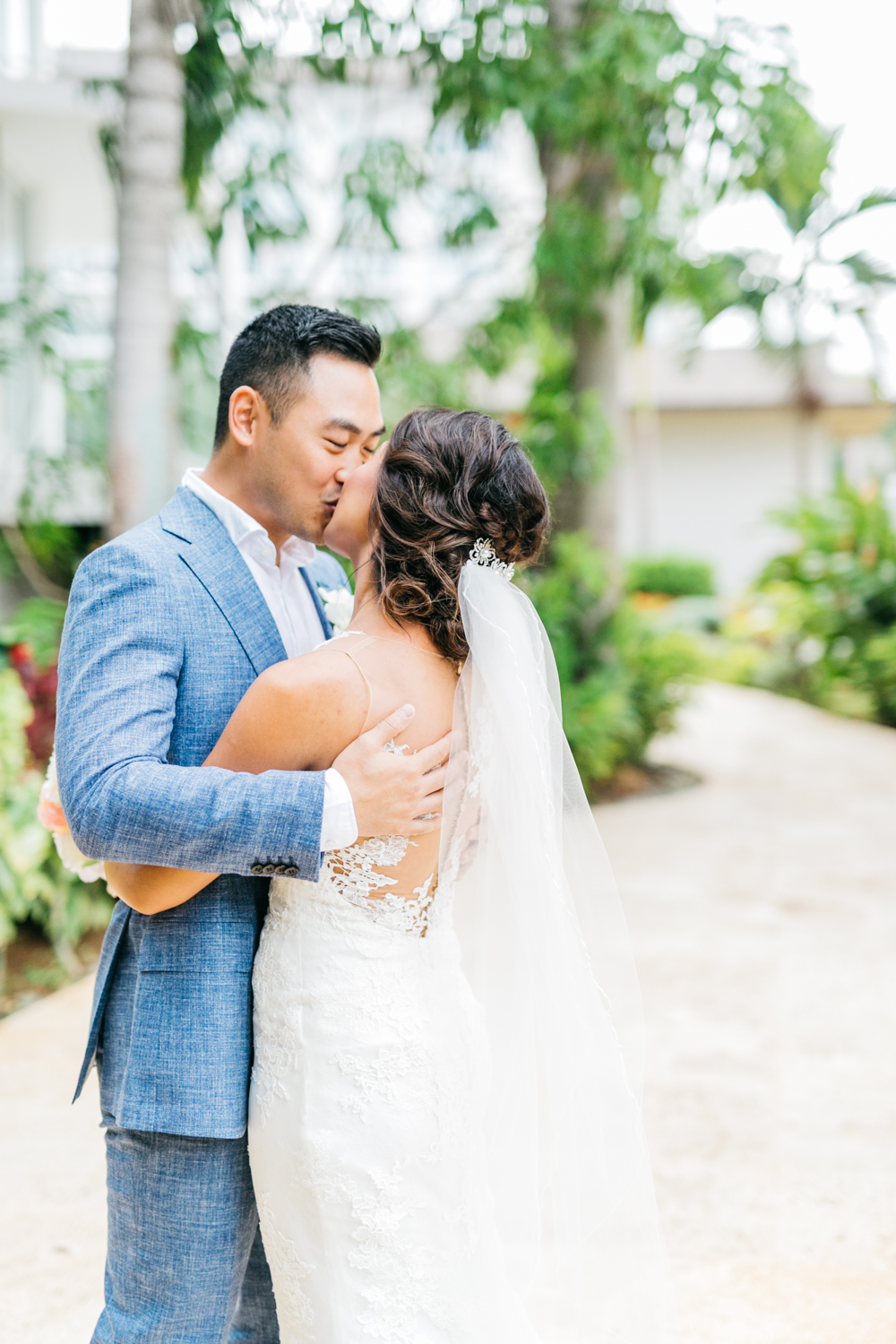 Bride and groom embracing each other at wedding