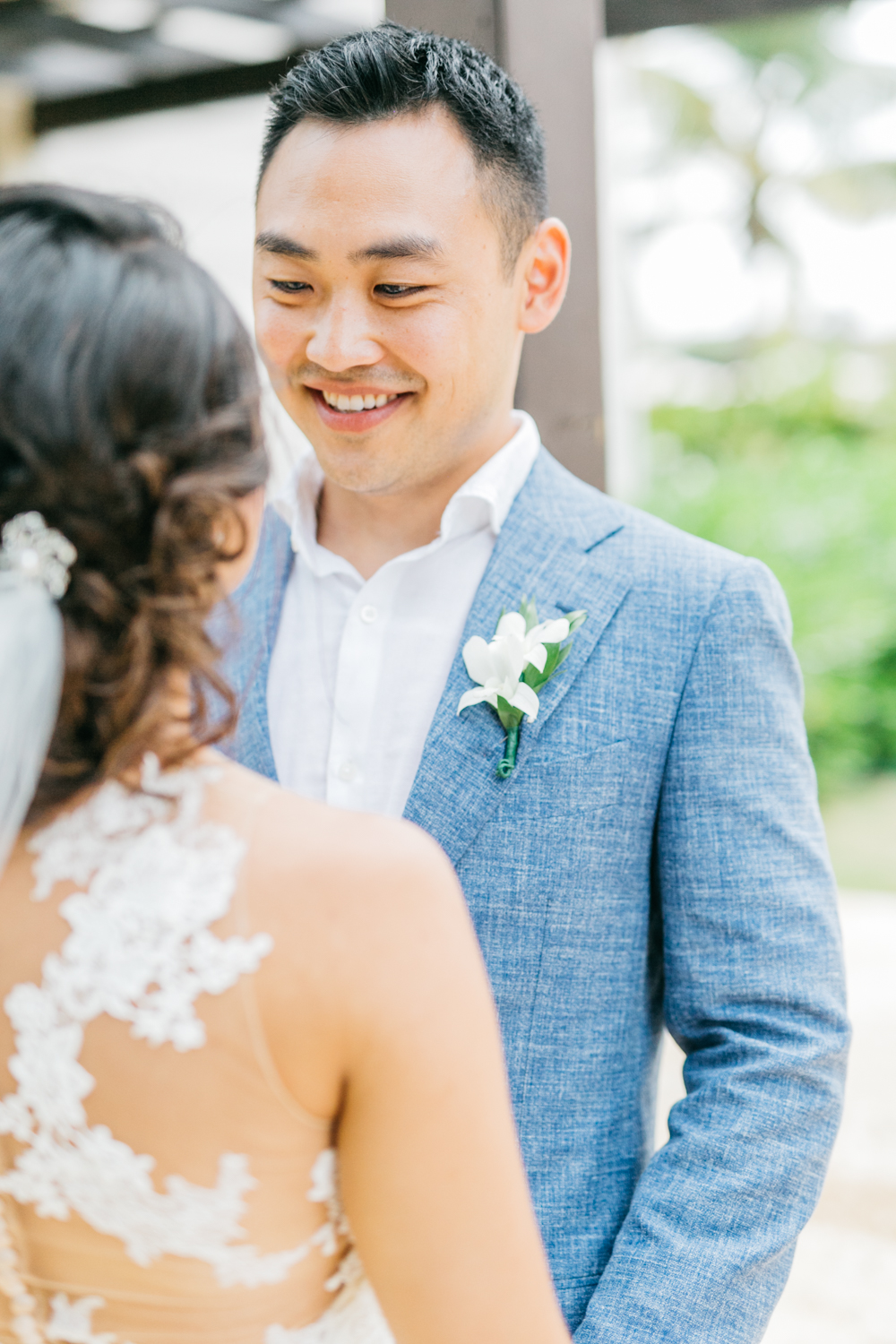 Groom smiling at bride during first look at Royalton White Sands Resort in Jamaica