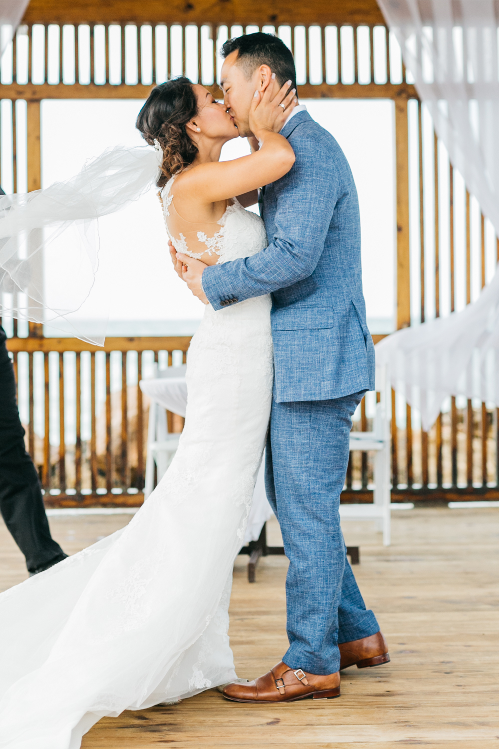 Bride and groom's first kiss at Royalton White Sands Resort in Jamaica
