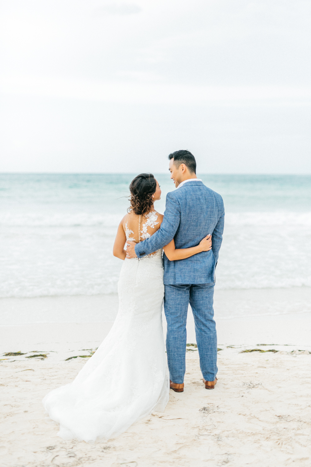 Bride and groom holding each othat at Royalton White Sands Resort in Jamaica