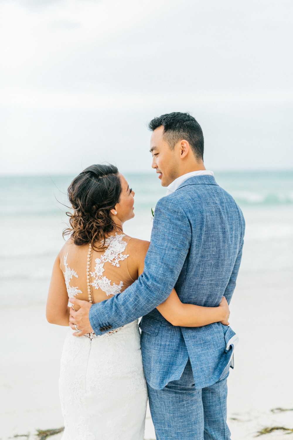 Bride and groom looking at each other at Royalton White Sands Resort in Jamaica