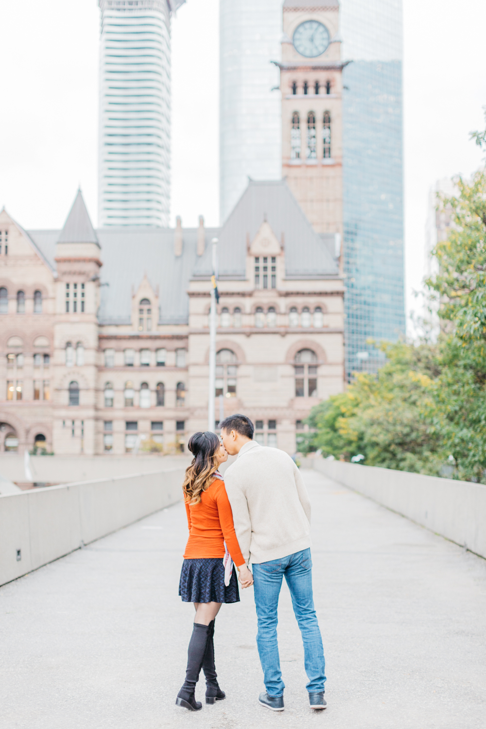 Couple kissing at Nathan Phillips Square