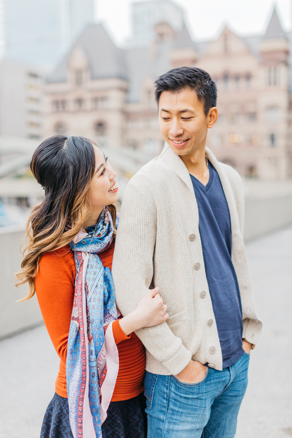 Couple looking at each other at Nathan Phillips Square