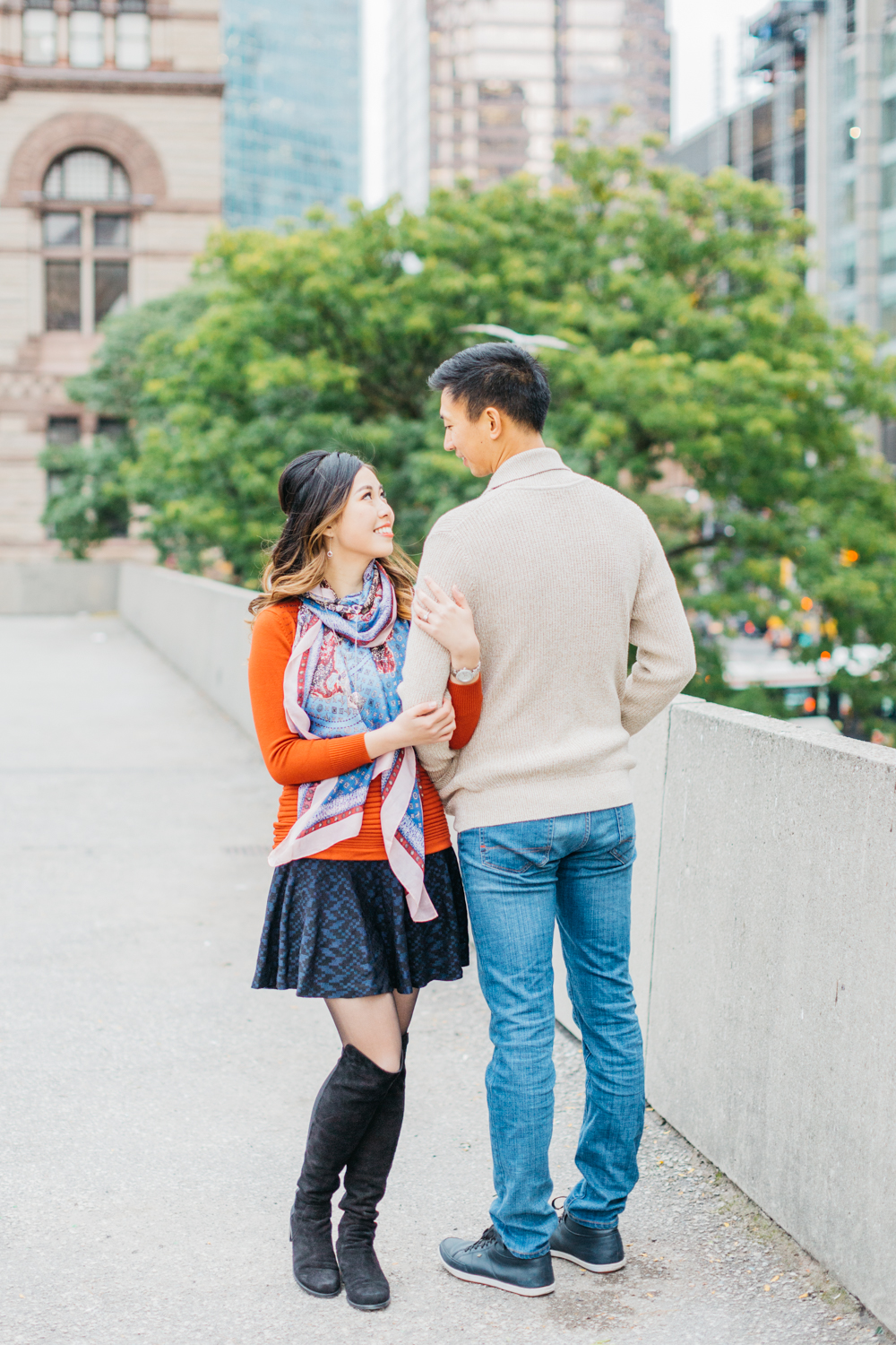 Couple looking at each other during engagement at Nathan Phillips Square
