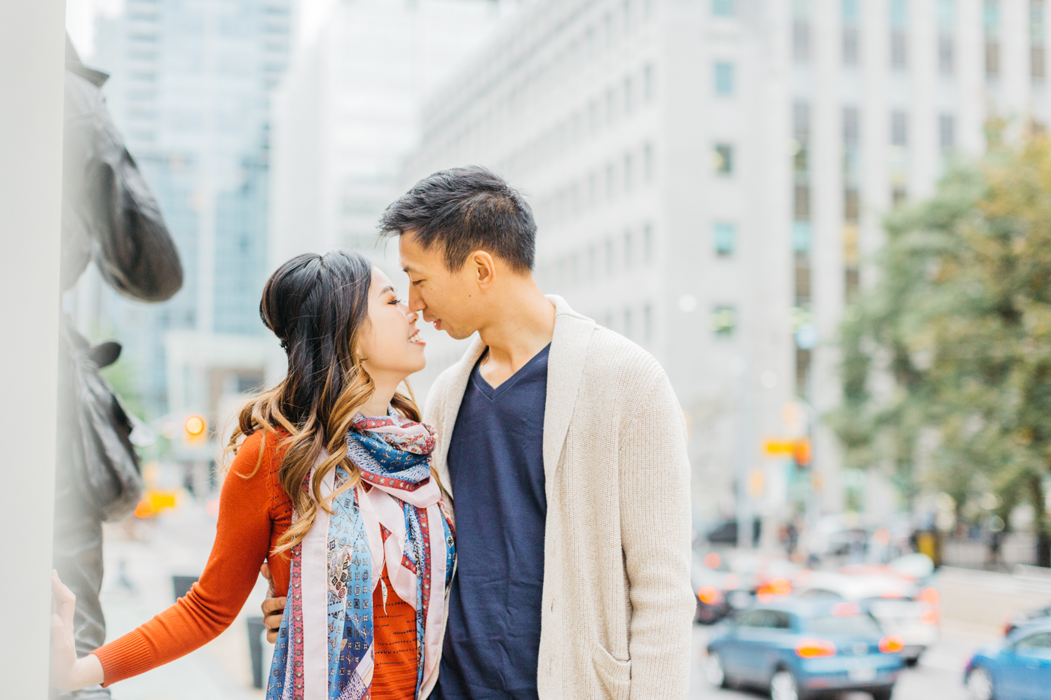 Couple going for a kiss during fall engagement session in toronto