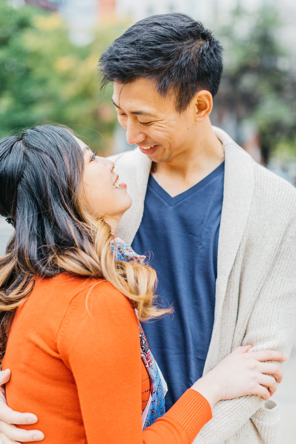 couple laughing during romantic fall engagement in Toronto
