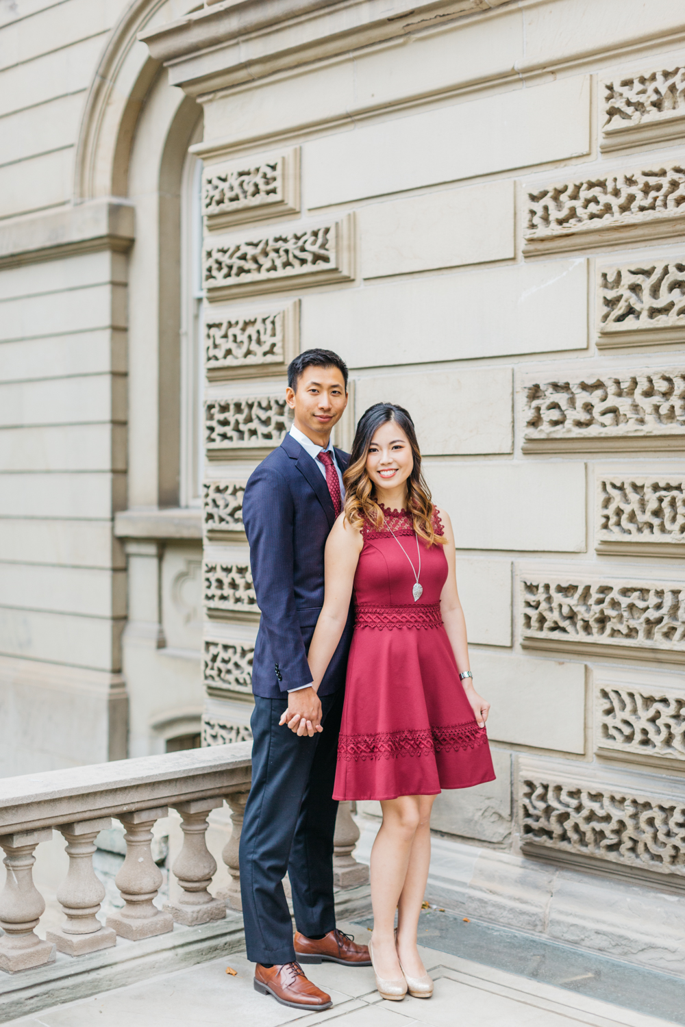 Couple holding hands during romantic Osgoode hall engagement