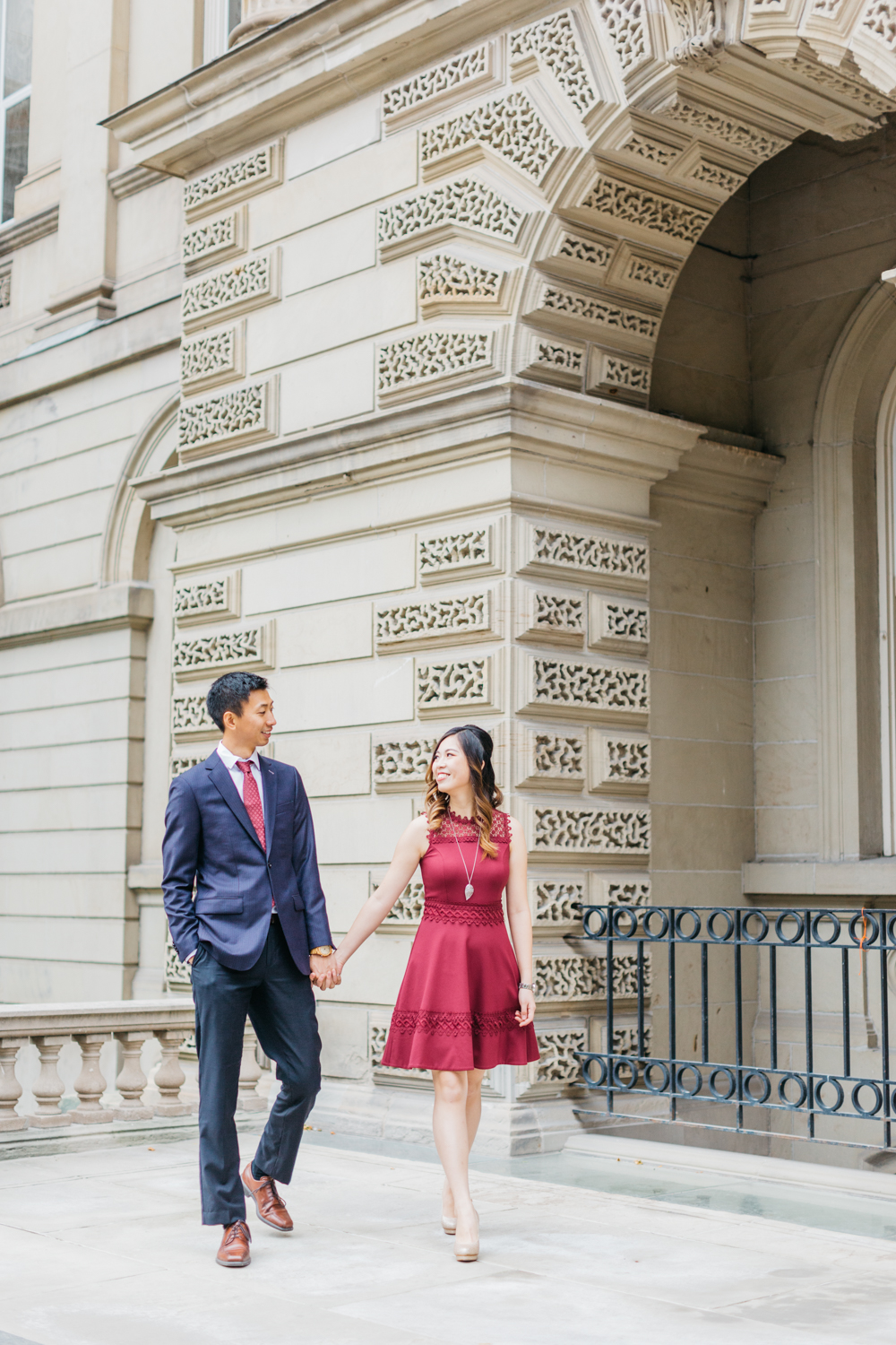 couple walking in formal outfits at osgoode hall