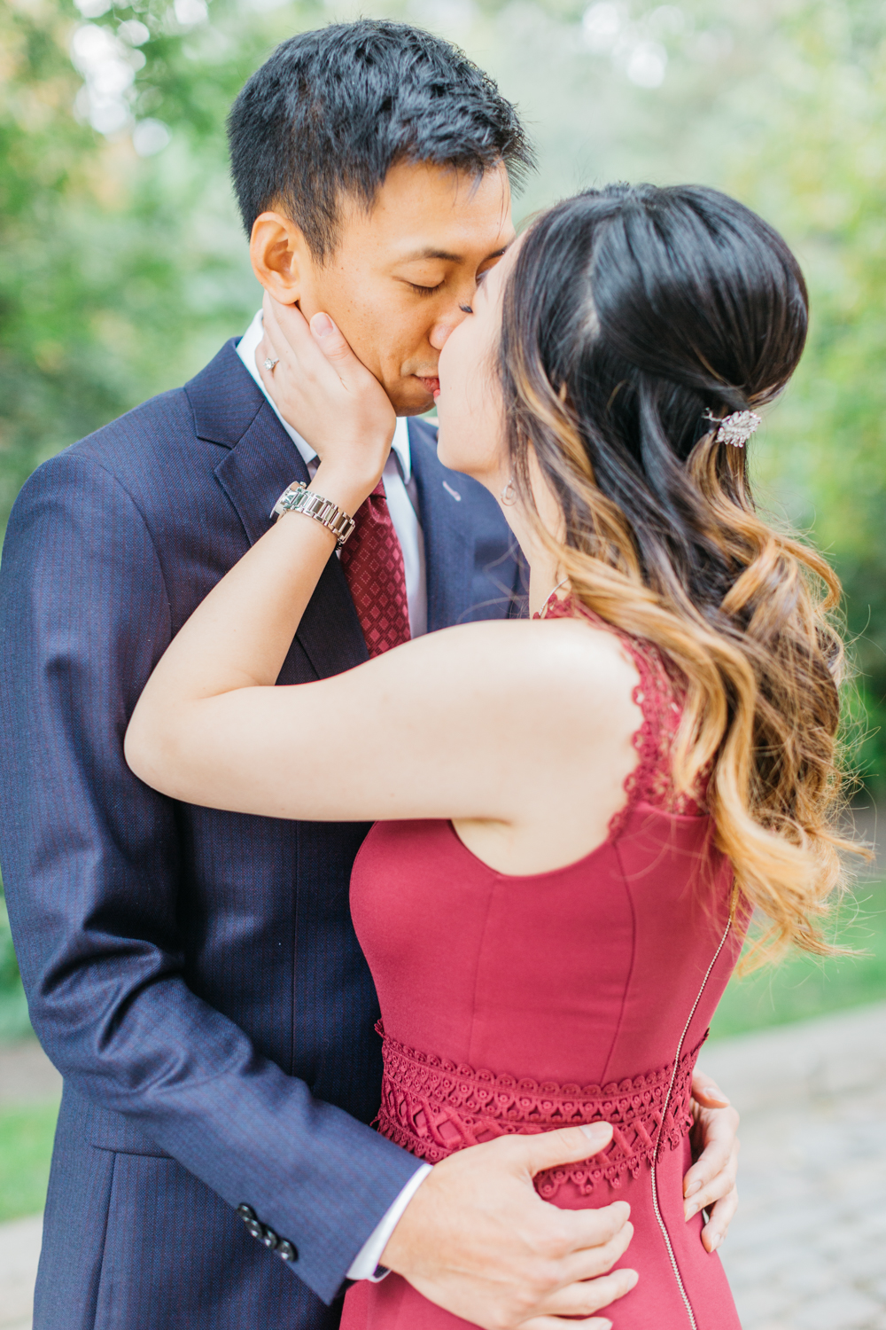 couple kissing during fall engagement shoot in toronto
