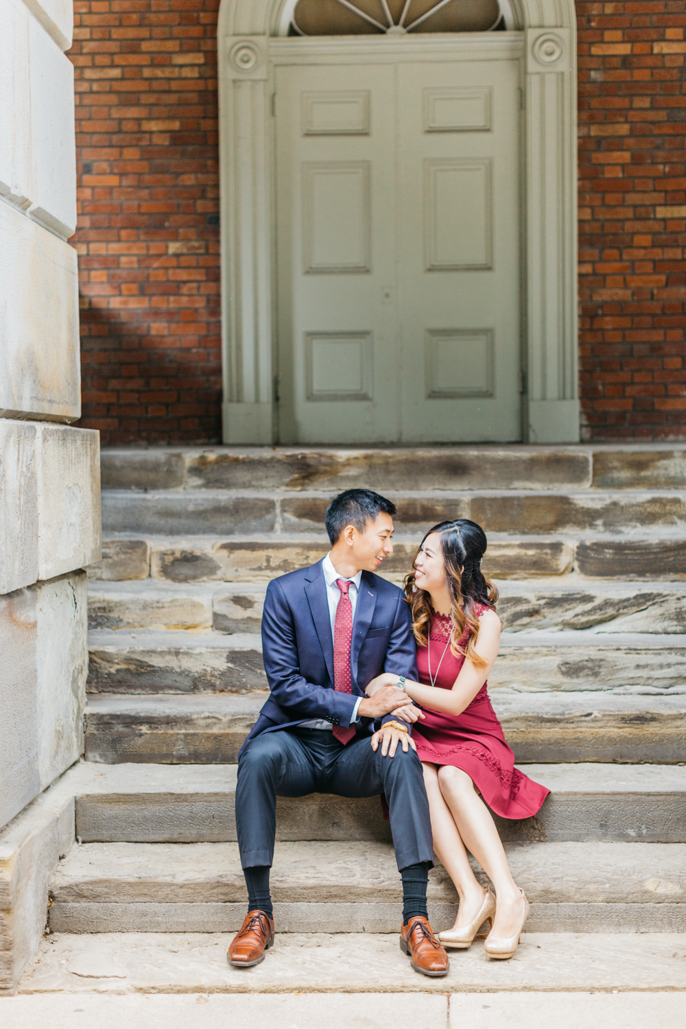 Couple sitting on steps at Osgoode Hall talking